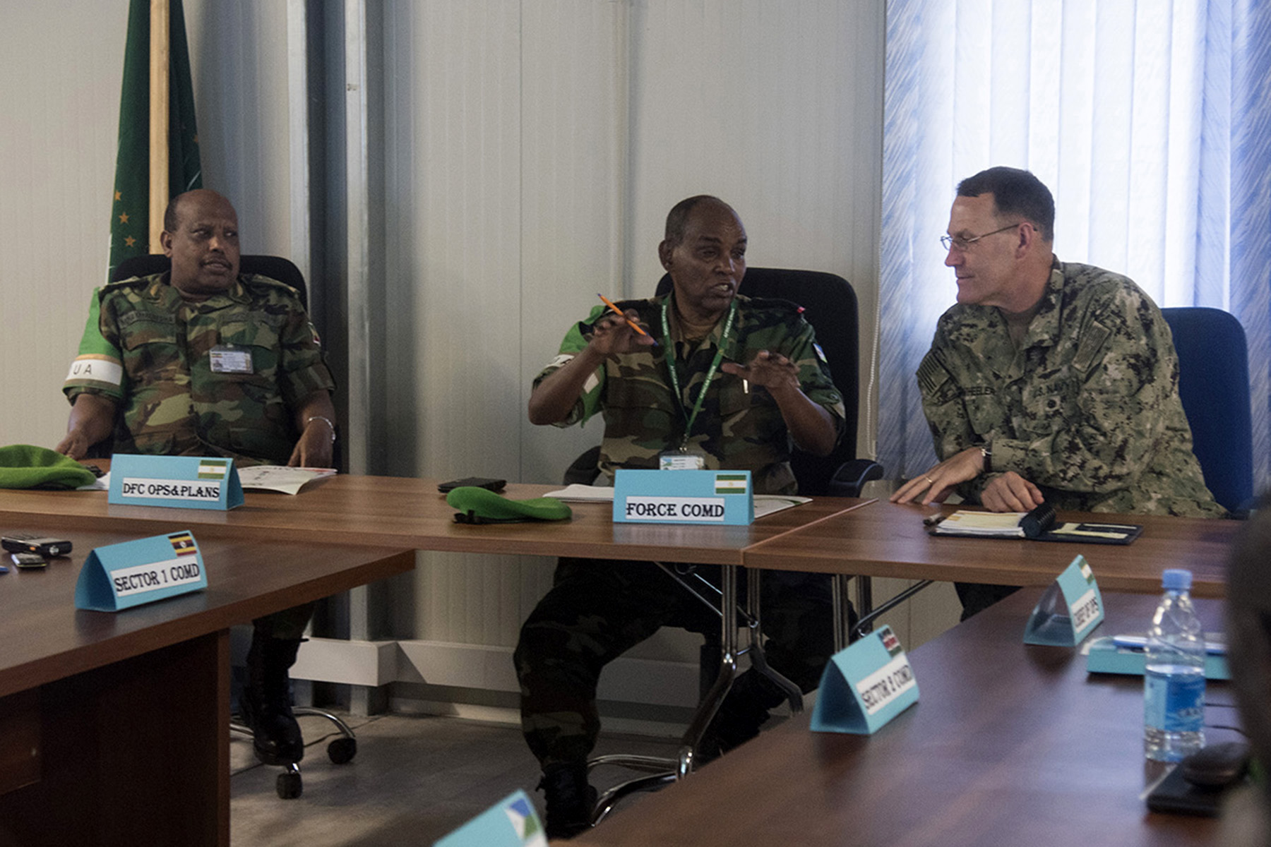 MOGADISHU, Somalia- U.S. Navy Rear Adm. William Wheeler (right), Combined Joint Task Force-Horn of Africa deputy commander, speaks with African Union Mission in Somalia Force Commander Lt. Gen. Osman Noor Soubagleh (middle) and Maj. Gen. Mohammed Ishu, AMISOM deputy commander for operations (left).  The leaders attended an AMISOM/Somali National Army Sector Commanders' conference, Aug. 25, 2016, at the AMISOM Force Headquarters in Mogadishu, Somalia. The conference brings together senior military leaders from each sector to review efficiency and needed improvements for security operations and SNA collaboration strategies. (U.S. Air Force photo by Staff Sgt. Tiffany DeNault)