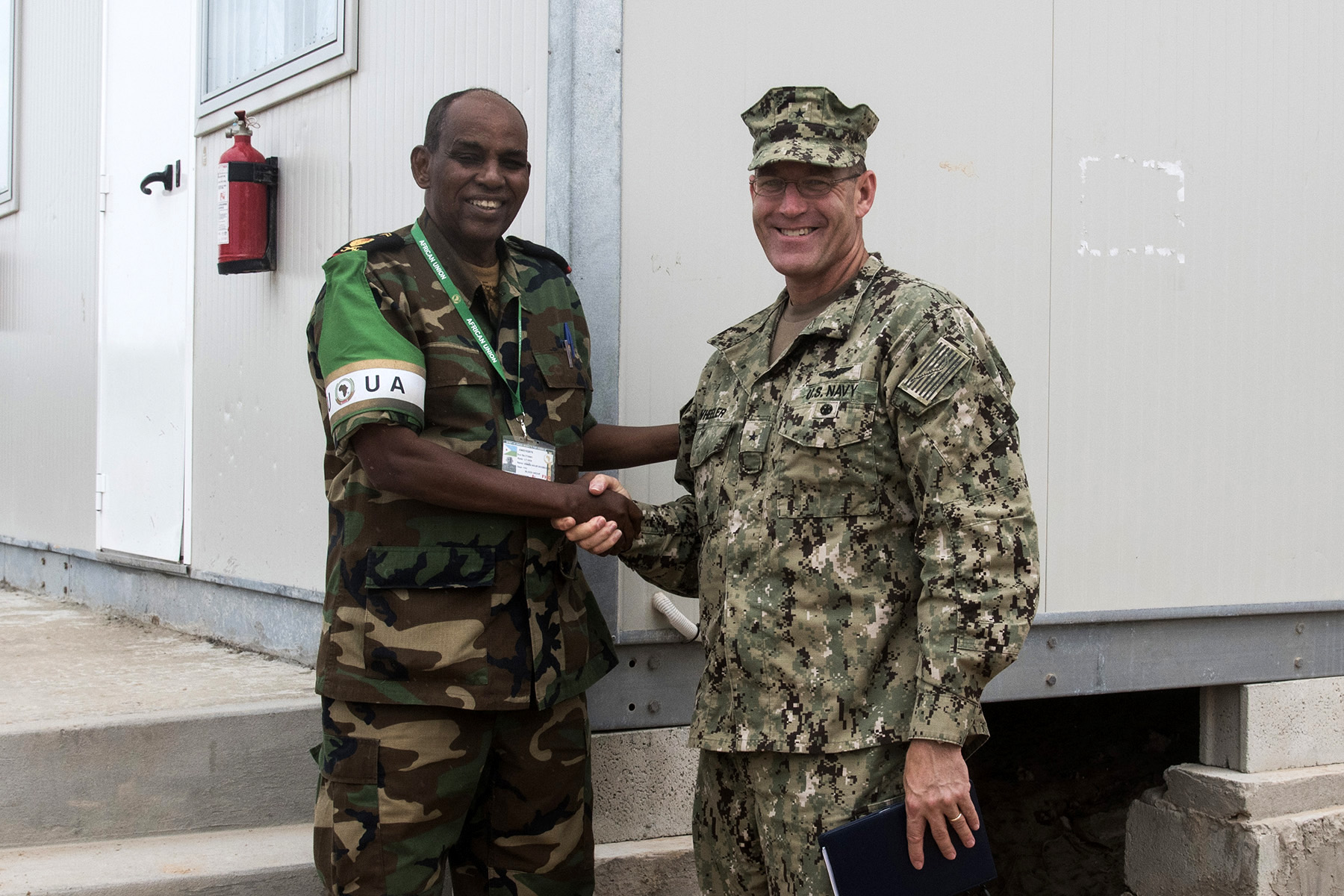 MOGADISHU, Somalia- African Union Mission in Somalia Lt. Gen. Osman Noor Soubagleh, force commander, meets with U.S. Navy Rear Adm. William Wheeler, Combined Joint Task Force-Horn of Africa deputy commander, during an AMISOM/Somali National Army Sector Commanders' conference, Aug. 25, 2016, at the AMISOM Force Headquarters in Mogadishu, Somalia. The Somali sector commanders met to review efficiency and needed improvements for security operations and SNA collaboration strategies. Lt. Gen. Soubagleh is from Djibouti, one of the five AMISOM nations that have combat troops working to secure Somalia.  (U.S. Air Force photo by Staff Sgt. Tiffany DeNault)