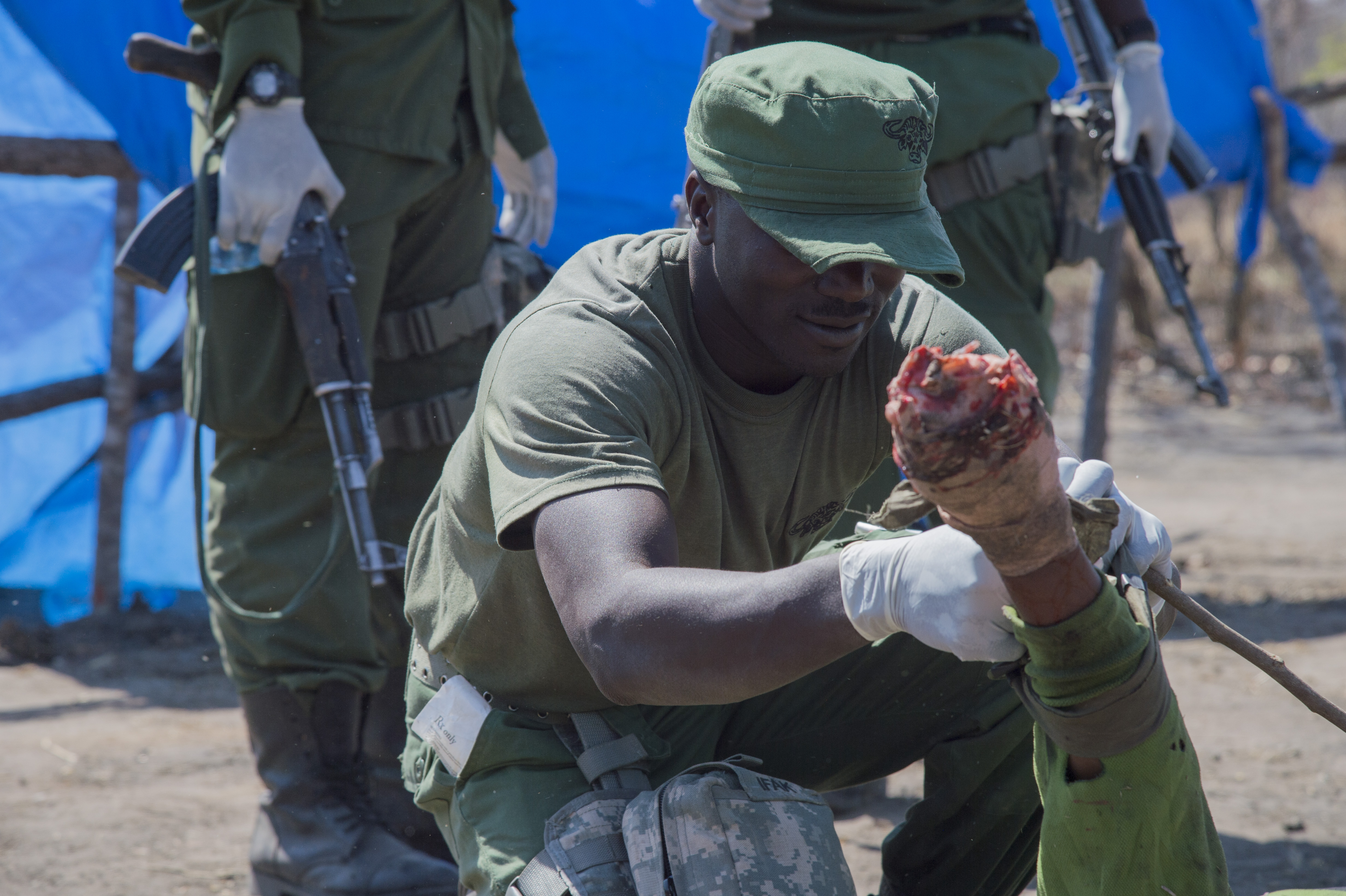 A Rungwa Game Reserve game warden applies a tourniquet to a simulated amputee during training Aug. 23, 2016, at Rungwa Game Reserve, Tanzania. Members form the 403rd Civil Affairs Battalion, a component of Joint Task Force - Horn of Africa, and North Carolina Army National Guard taught the rangers techniques to increase their skills in small unit tactics, first aid, gathering intelligence and other field crafts.  The soldiers were training the rangers in how to combat poachers on the reserve.  Poaching and trafficking in wildlife has become a source of revenue for violent extremist organizations on the continent. (U.S. Air Force photo by Staff Sgt. Eric Summers Jr./Released)