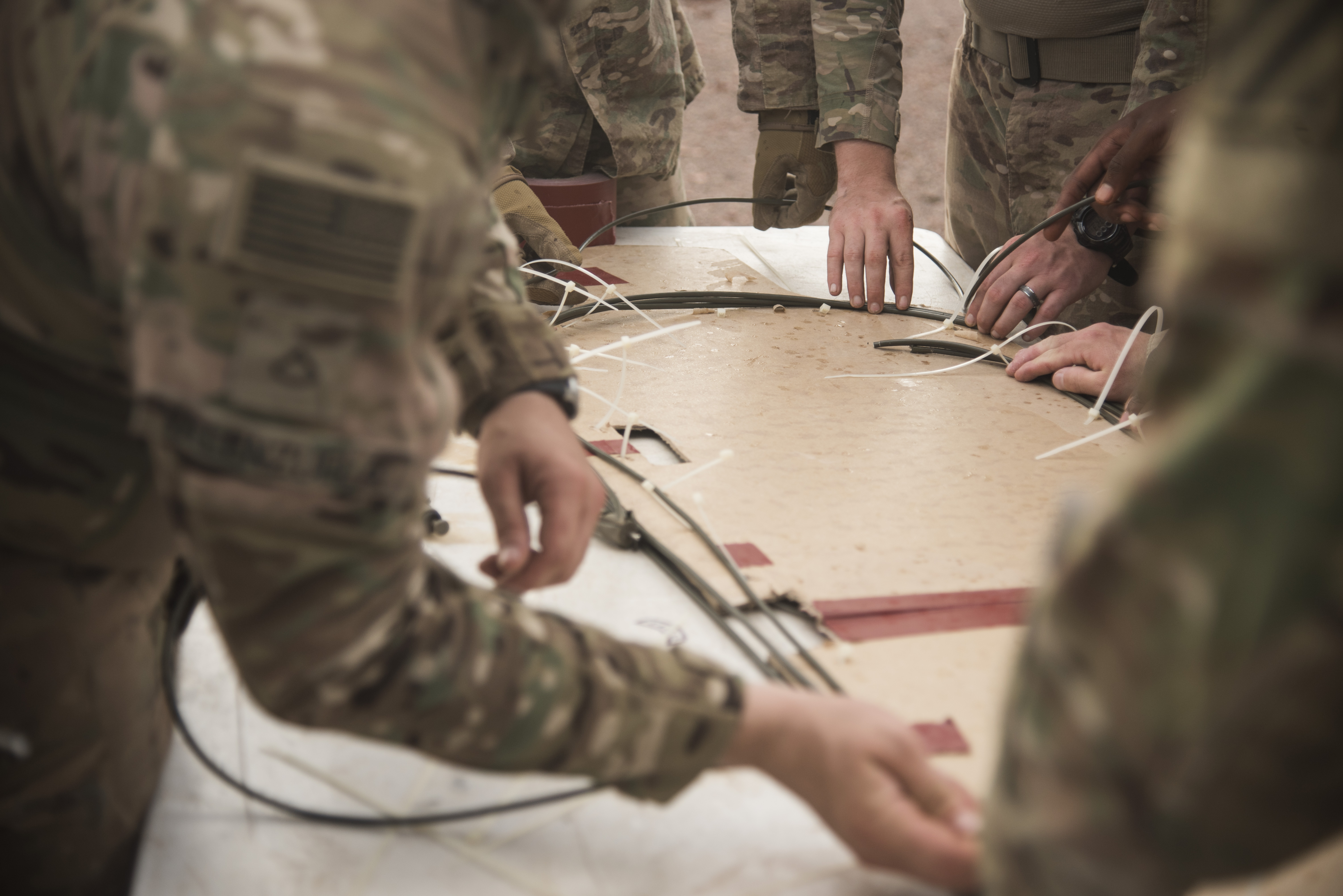 U.S. Army Soldiers from Bravo Company, 3rd Battalion, 15th Infantry Regiment, place M14 time fuse cords around a piece of cardboard during demolition training, Aug. 30, 2016, in Arta, Djibouti.  Bravo Co., 3/15 Inf. Rgt., from Fort Stewart, Ga., serves as the East Africa Response Force assigned to Combined Joint Task Force-Horn of Africa to provide rapid response and security to protect embassies and foreign assets in the area of responsibility of CJTF-HOA. (U.S. Air Force photo by Staff Sgt. Tiffany DeNault)