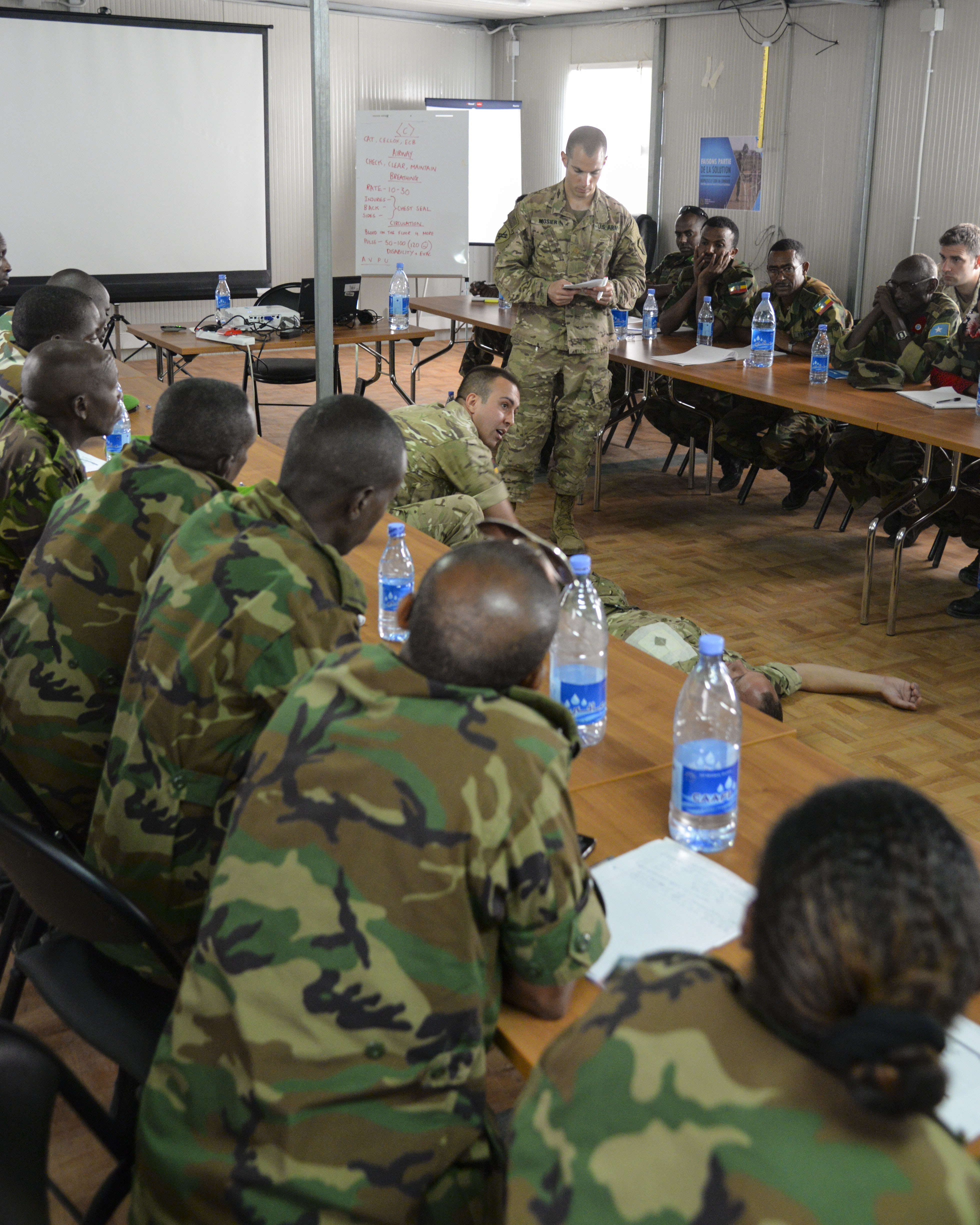 U.S. Army Maj. Andrew Mosier, 403rd Civil Affairs Battalion physician, shares best practices with African Union Mission in Somalia and Somali combat medics about methods of providing casualty care under hostile fire during the AMISOM Sector Medical Conference in Mogadishu, Somalia, Sept. 6, 2016. During the conference, medics practiced triage (a method of prioritizing care among multiple casualties to save the most lives), applying multiple tourniquets in a mass casualty exercise, and maintaining effective communication in a crisis. (U.S. Air Force photo by Staff Sgt. Benjamin Raughton)
