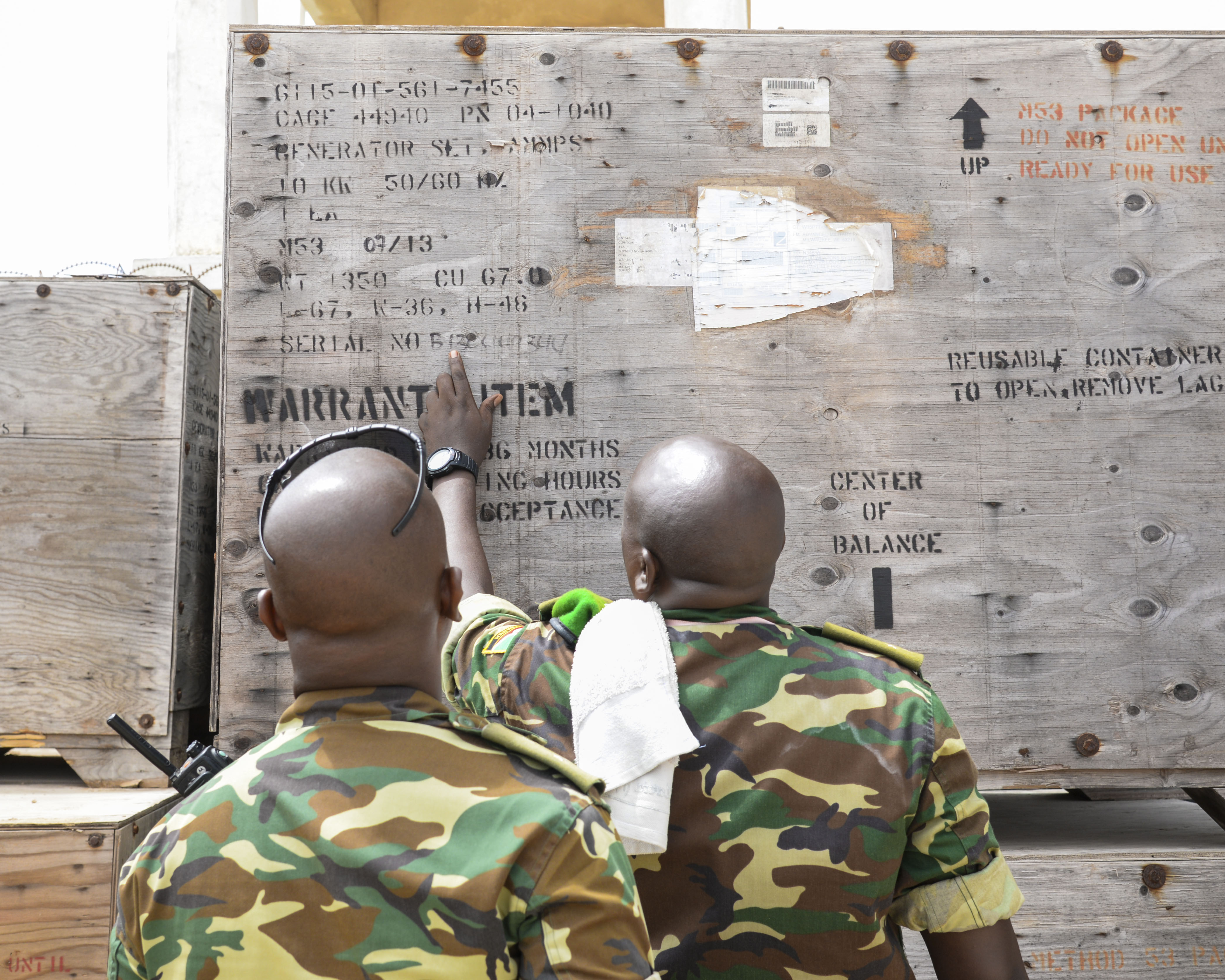 Soldiers from the Burundi National Defense Force verify a power generator's serial number in Mogadishu, Somalia, Sept. 12, 2016. Both Burundi and U.S. forces verified the product serial numbers to verify that items shipped from the U.S. overseas to Somalia were specifically what was requested, and that inventory management was maintained. (U.S. Air Force photo by Staff Sgt. Benjamin Raughton)