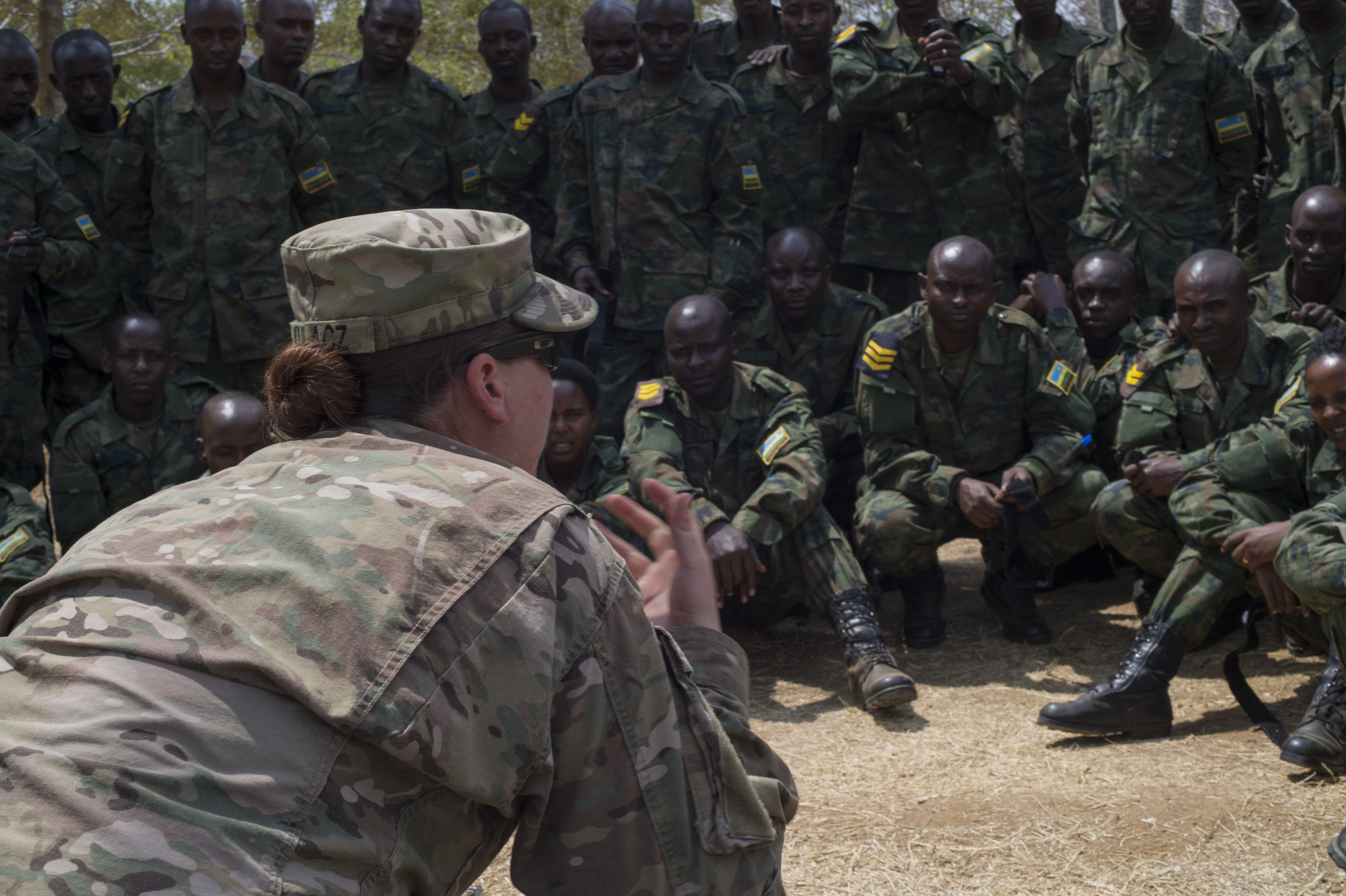U.S. Army Sgt. Isabella Kulacz, 1st Battalion, 124th Infantry Regiment medic, instructs Rwanda Defense Force soldiers on controlling the airway during a two-week medical course Sept. 8, 2016, at Rwanda Military Academy, Rwanda. Kulacz and Sgt. Jonathan Lopez, both medics with the 1/124 Inf. Rgt., assigned to Combined Joint Task Force-Horn of Africa, taught the students techniques equivalent to the U.S. Army's Combat Lifesaver Skills course. (U.S. Air Force photo by Staff Sgt. Eric Summers Jr.)