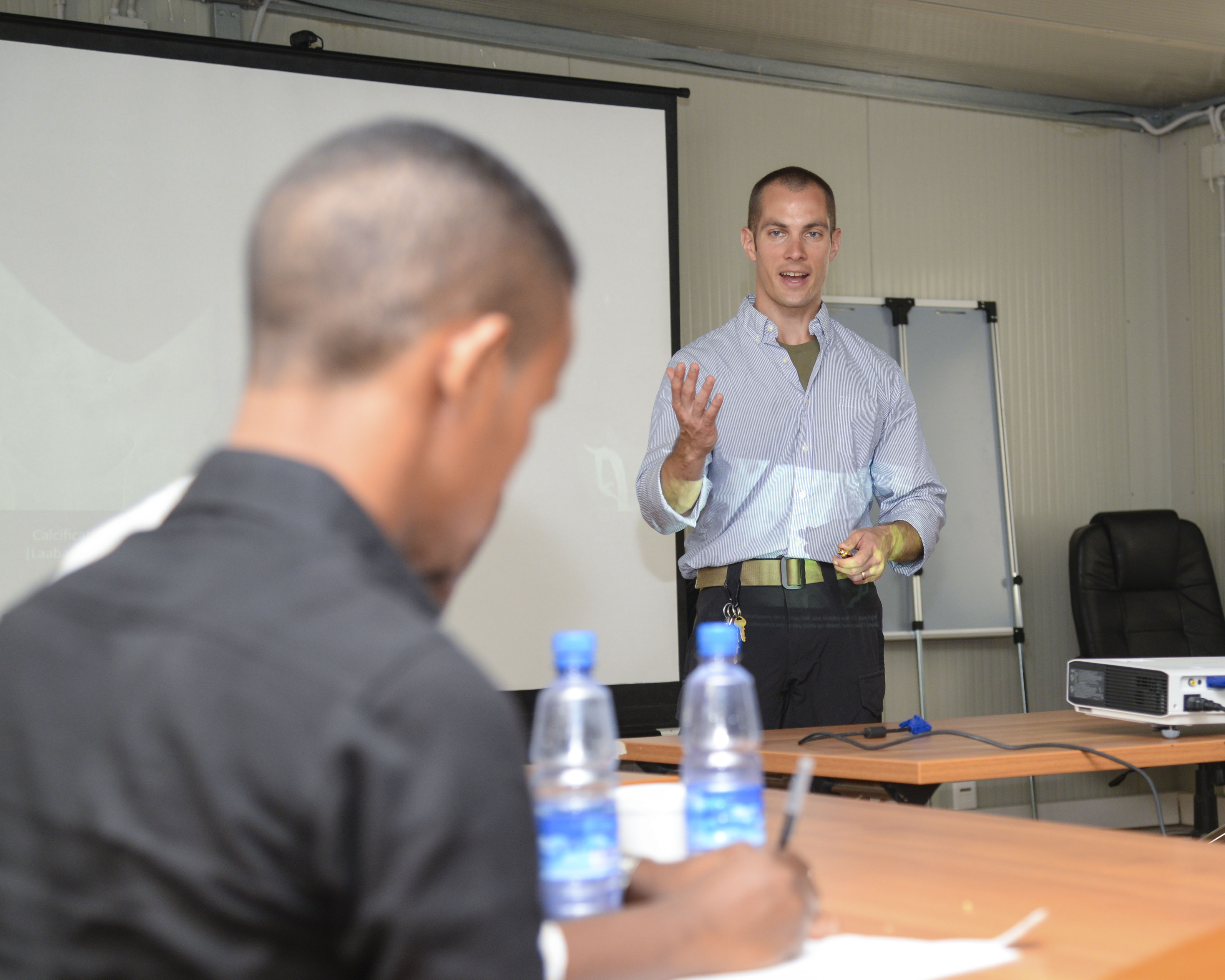 U.S. Army Maj. Andrew Mosier, 403rd Civil Affairs Battalion physician, instructs nearly 20 Somali doctors during the Continuing Medical Education Conference in Mogadishu, Somalia, Sept. 14, 2016. The conference covered topics concerning treatment for different types of broken bones, swollen lymph nodes, and arthritis, and they also practiced reading radiographs. (U.S. Air Force photo by Staff Sgt. Benjamin Raughton)
