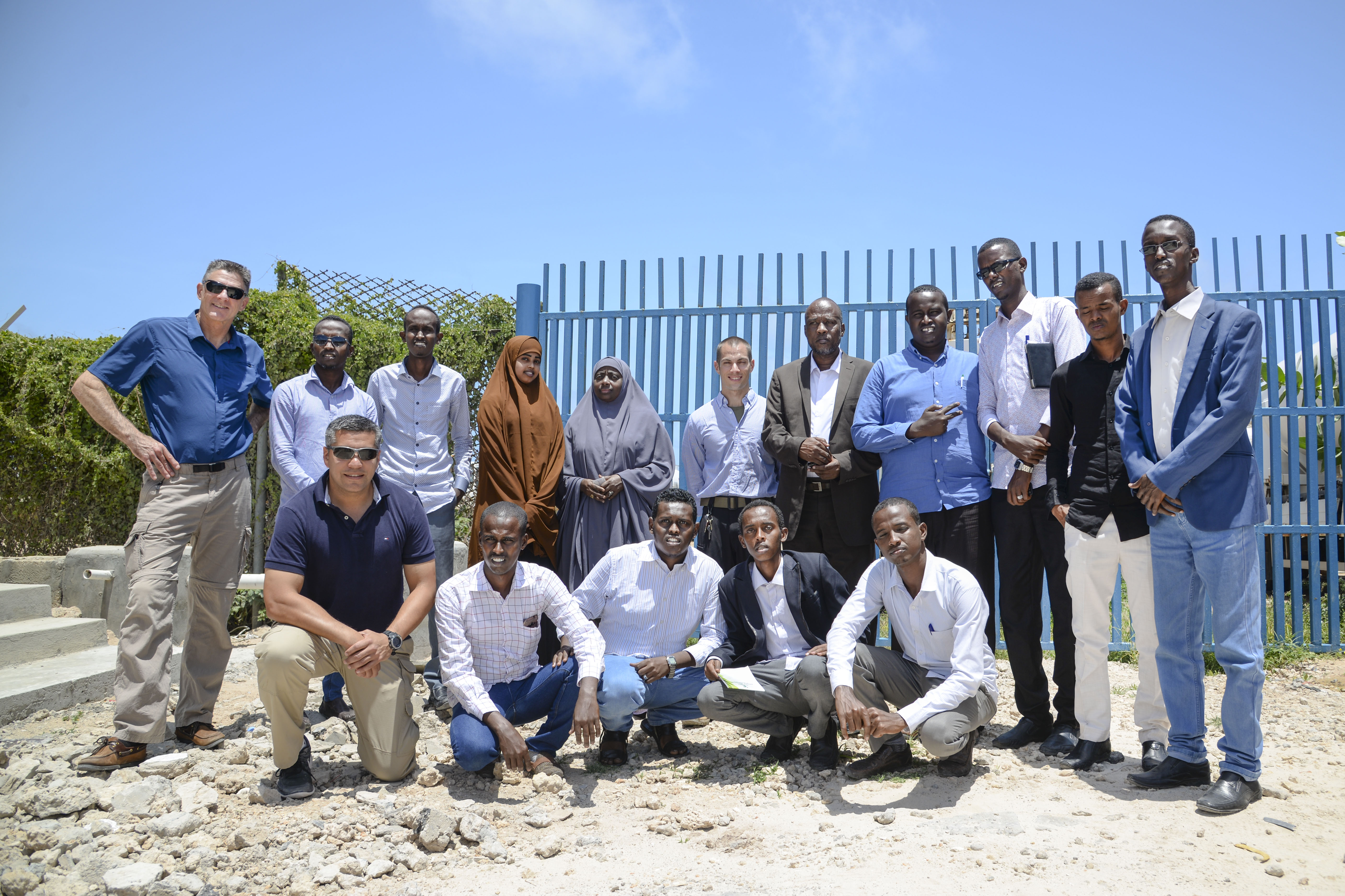 Doctors, attendees and facilitators of the Continued Medical Education conference pose for a photo in Mogadishu, Somalia, Sept. 14, 2016. The conference brought nearly 20 medical students and general practitioners from various sectors of Somalia together to receive training various medical practices, specifically in the field of radiology and pediatrics. (U.S. Air Force photo by Staff Sgt. Benjamin Raughton)