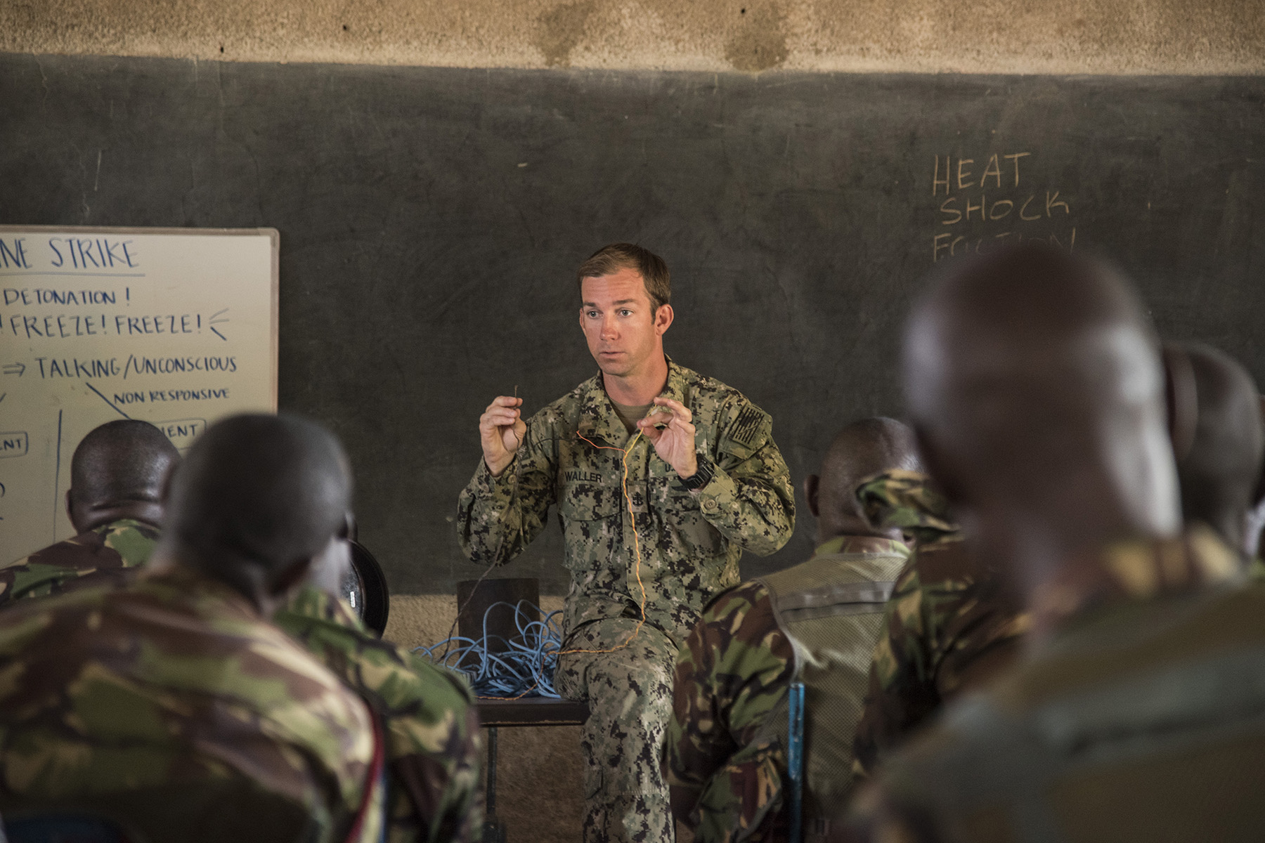 KENYA- U.S. Navy Chief Petty Officer Ryan Waller, assigned to Task Force Sparta and senior instructor for Deliberate Kindle 2016, teaches Kenya Defense Forces combat engineer soldiers and officers on the difference between electric and non-electric explosives during Deliberate Kindle 2016, Sept. 16, at a training center in Kenya. Deliberate Kindle is a four-week counter-improvised explosive device course designed to provide C-IED, medical, and train-the-trainer skills to approximately 53 KDF soldiers in preparation for future deployments with the African Union Mission in Somalia. (U.S. Air Force photo by Staff Sgt. Tiffany DeNault)