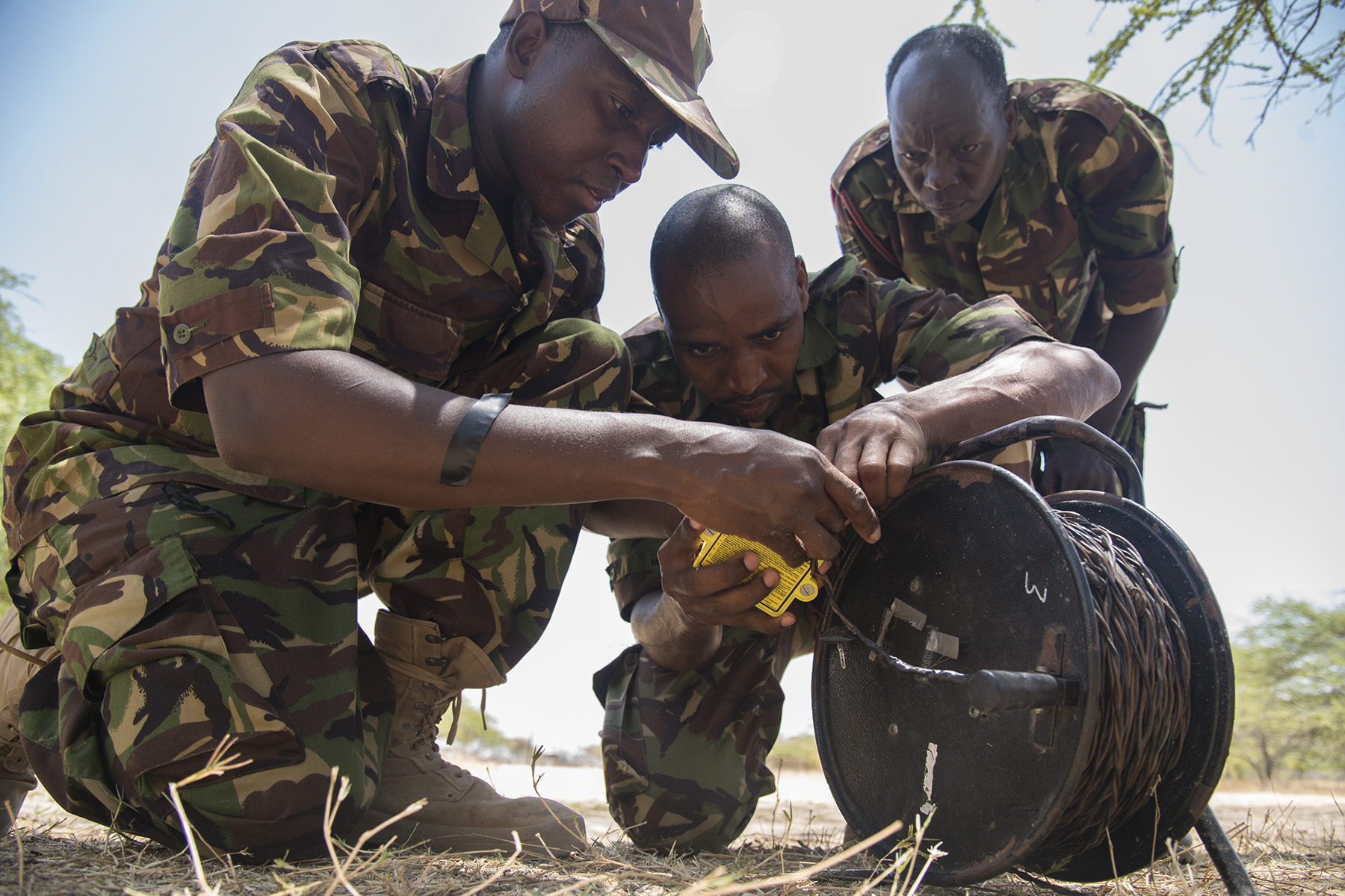 KENYA- Kenya Defense Forces combat engineers practice setting up an electric demolition with mock training aids during Deliberate Kindle 2016, Sept. 16, at a training center in Kenya. U.S. Navy Task Force Sparta explosive ordnance disposal technicians and a dive independent duty corpsman, assigned to Combined Joint Task Force-Horn of Africa, provided counter-improvised explosive device, tactical combat medical care, and train-the-trainer skills to approximately 53 KDF soldiers and officers in preparation the KDF's deployment with the African Union Mission in Somalia. (U.S. Air Force photo by Staff Sgt. Tiffany DeNault)