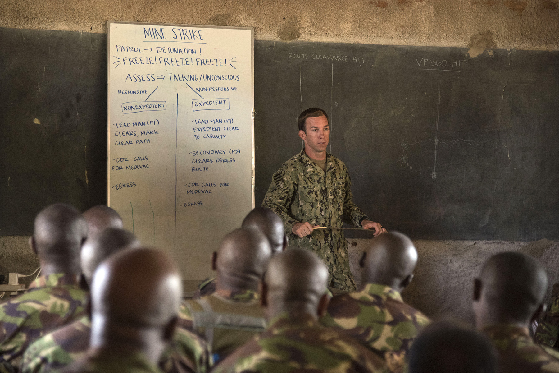 KENYA- U.S. Navy Chief Petty Officer Ryan Waller, Task Force Sparta explosive ordnance disposal technician and Deliberate Kindle instructor, explains the final portion of the tactical combat medical training to Kenyan Defense Force combat engineers during Deliberate Kindle 2016, Sept. 15, at a Kenyan training facility. The medical training was just one portion of the four-week course designed to give Humanitarian Mine Action training to course attendees, so as to prepare them for future deployments with the African Union Mission in Somalia. (U.S. Air Force photo by Staff Sgt. Tiffany DeNault)