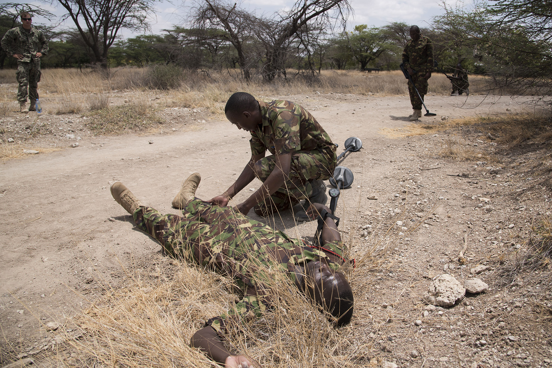 KENYA – Kenyan Defense Force combat engineers conduct simulated medical care during a mine strike exercise as part of tactical combat medical training for Deliberate Kindle 2016, Sept. 15, at a Kenyan training facility. The medical training was just one portion of the four-week course taught by Task Force Sparta, which is currently deployed to Combined Joint Task Force-Horn of Africa. The course was designed to give Humanitarian Mine Action training to course attendees, so as to prepare them for future deployments with the African Union Mission in Somalia. (U.S. Air Force photo by Staff Sgt. Tiffany DeNault)