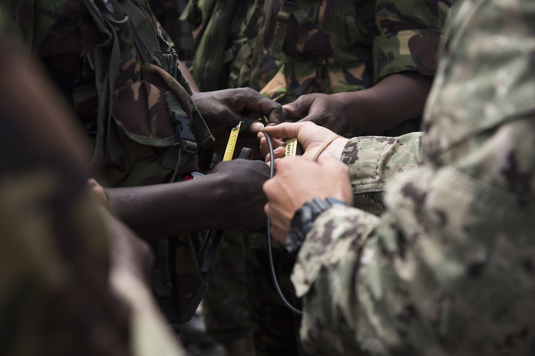 KENYA- Kenya Defense Force combat engineer soldiers and officers measure time fuse for timing calculations during demolition training taught by U.S. Navy Sailors from Task Force Sparta during Deliberate Kindle 2016, Sept. 19, at a training center in Kenya. Deliberate Kindle 2016 is taught by U.S. Navy explosive ordnance disposal technicians and a dive independent duty corpsman assigned to Combined Joint Task Force-Horn of Africa.  It is a four-week Humanitarian Mine Action course designed to provide training in countering improvised explosive devices and unexploded ordnance, medical, and train-the-trainer skills to approximately 53 KDF soldiers, in preparation for future deployments with the African Union Mission in Somalia. (U.S. Air Force photo by Staff Sgt. Tiffany DeNault)