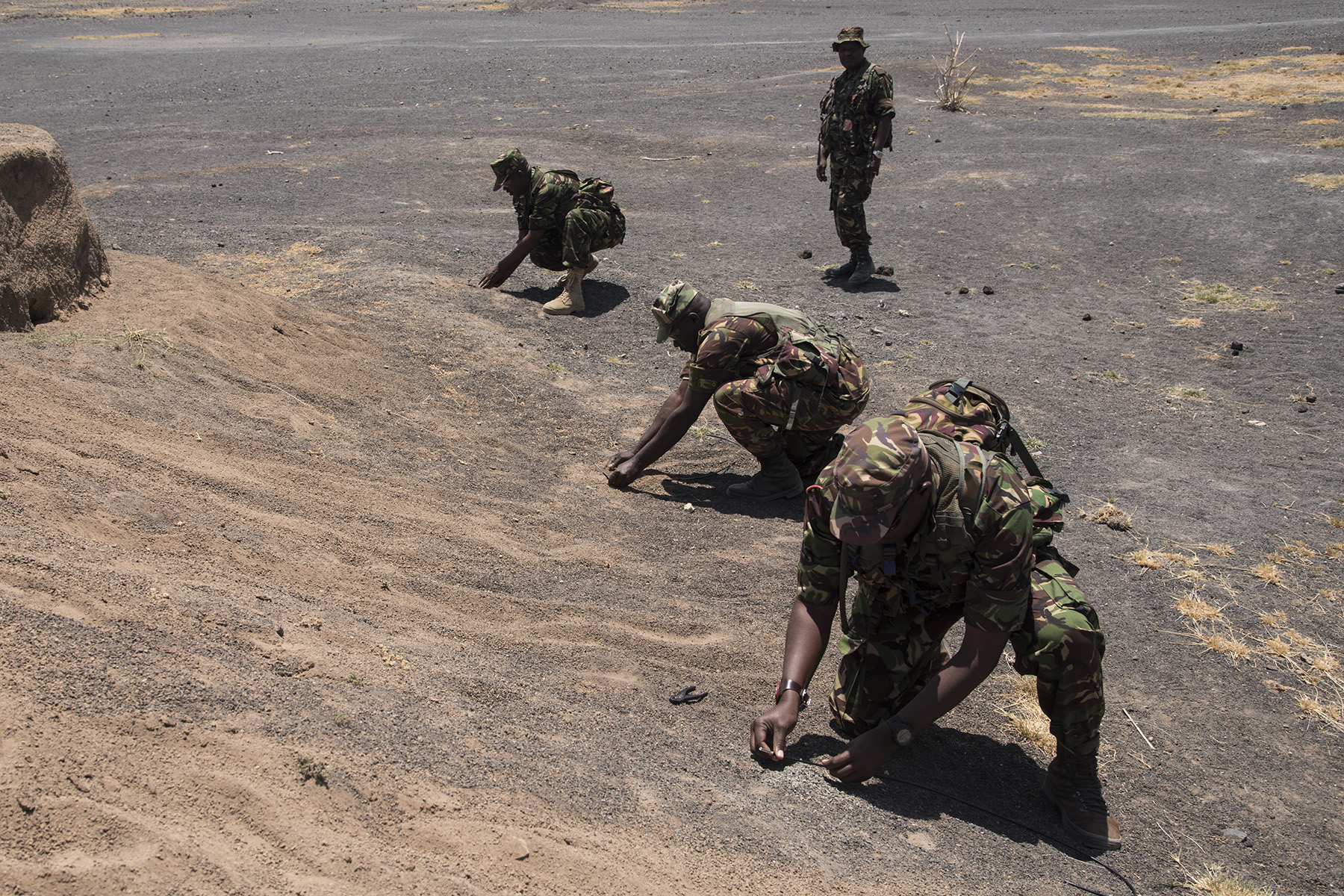 KENYA- Kenya Defense Forces soldiers prepare non-electric demolition charges during Deliberate Kindle 2016 taught by U.S. Navy Sailors from Task Force Sparta, Sept. 19, at a training center in Kenya. Deliberate Kindle 2016 is taught by U.S. Navy explosive ordnance disposal technicians and a dive independent duty corpsman assigned to Combined Joint Task Force-Horn of Africa.  It is a four-week Humanitarian Mine Action course designed to provide training in countering improvised explosive devices and unexploded ordnance, medical, and train-the-trainer skills to approximately 53 KDF soldiers in preparation for future deployments with the African Union Mission in Somalia. (U.S. Air Force photo by Staff Sgt. Tiffany DeNault)