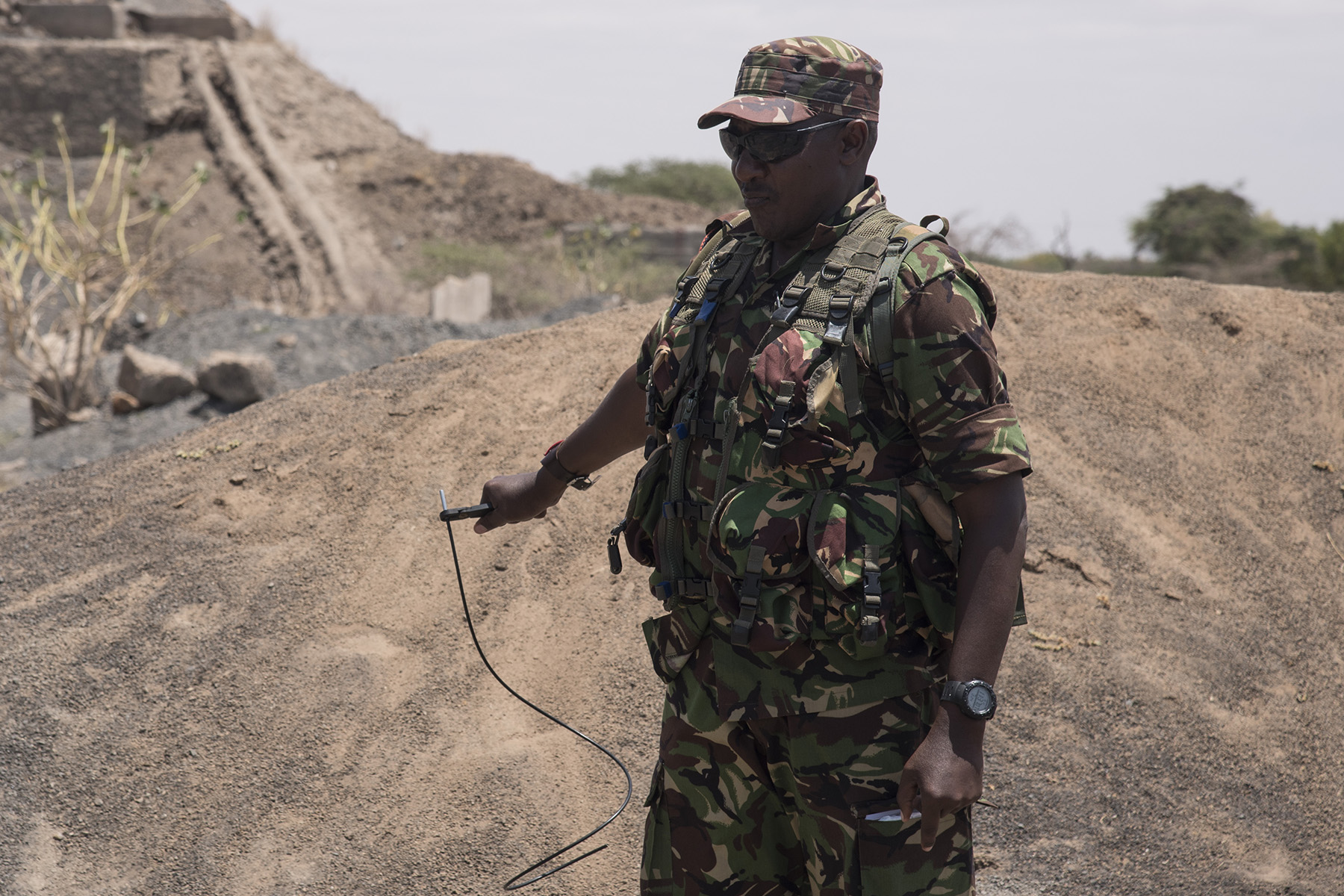 KENYA- Kenya Defense Forces Warrant Officer Athumani, squadron sergeant major, prepares a blasting cap during non-electric demolition training taught by U.S. Navy Sailors from Task Force Sparta during Deliberate Kindle 2016, Sept. 19, at a training center in Kenya. Deliberate Kindle 2016 is taught by U.S. Navy explosive ordnance disposal technicians and a dive independent duty corpsman assigned to Combined Joint Task Force-Horn of Africa.  It is a four-week Humanitarian Mine Action course designed to provide training in countering improvised explosive devices and unexploded ordnance, medical, and train-the-trainer skills to approximately 53 KDF soldiers in preparation for future deployments with the African Union Mission in Somalia. (U.S. Air Force photo by Staff Sgt. Tiffany DeNault)