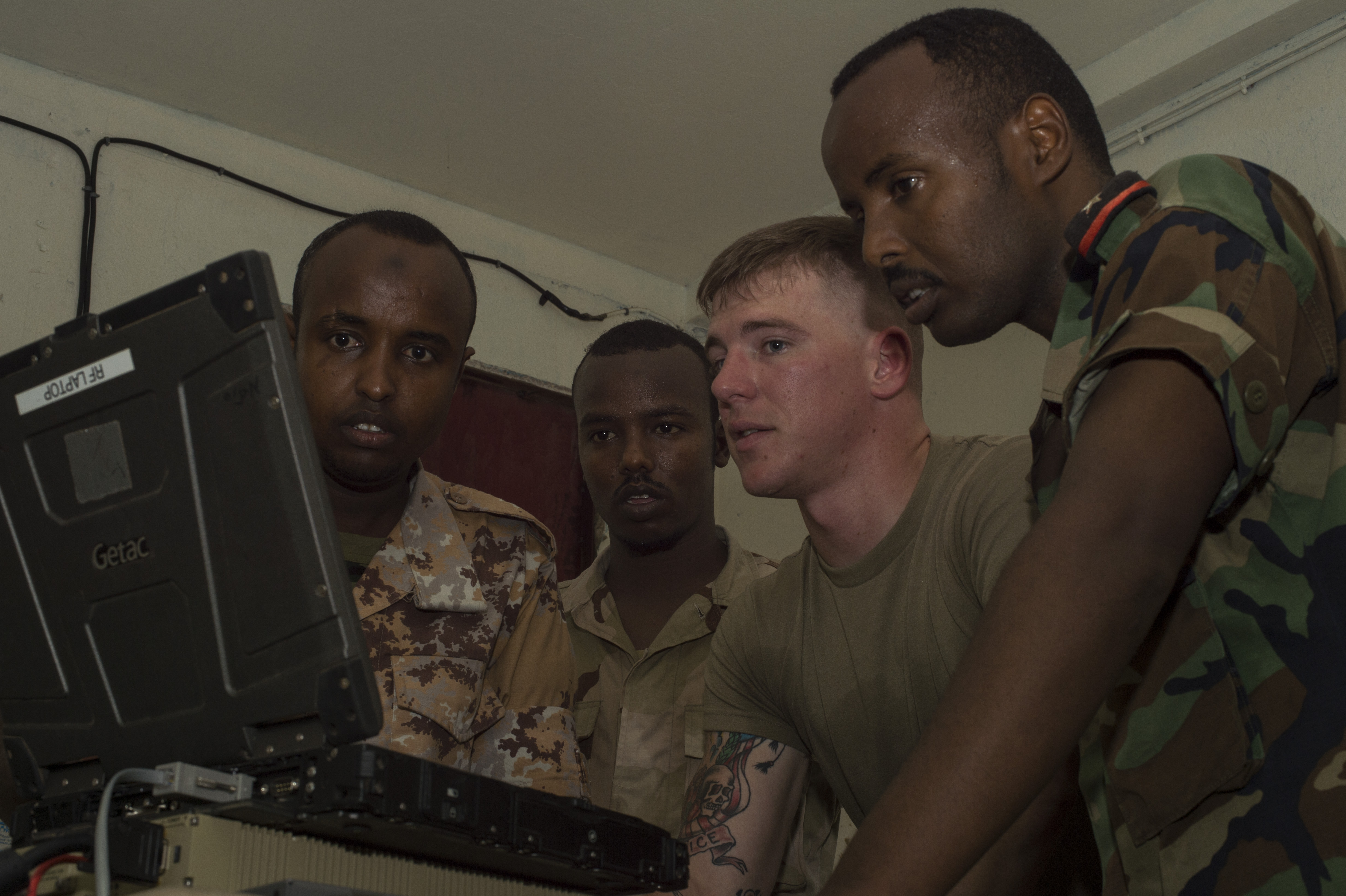 U.S. Army Spc. Dillin Hart, a Combined Joint Task Force-Horn of Africa technician on the Africa Data Sharing Network (ADSN) system, reviews network configurations with members of the Djibouti Armed Forces (FAD) during training validation Sept. 28, 2016, at FAD Headquarters in Djibouti.  While conducting the best practices training, the U.S. Army technicians assigned to Combined Joint Task-Horn of Africa, also held an ADSN validation with the FAD soldiers to prepare them to deploy to Somalia.  The ADSN provides network and Voice over Internet Protocol capabilities between the several African countries participating in the Africa Union Mission in Somalia. (U.S. Air Force photo by Staff Sgt. Eric Summers Jr.)