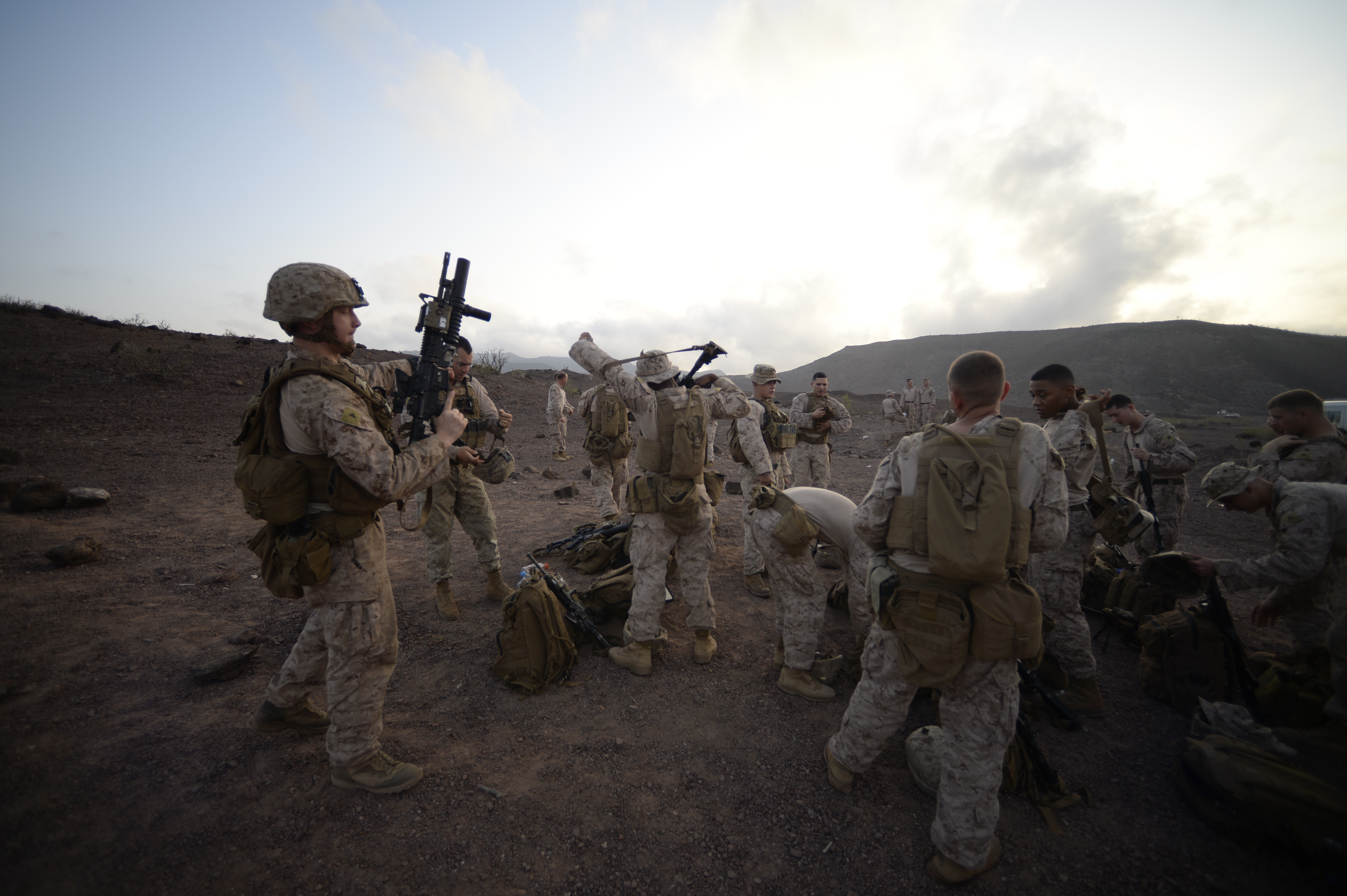 ARTA, Djibouti – U.S. Marines with Special-Purpose Marine Air-Ground Task Force Crisis Response-Africa (SPMAGTF-CR-AF), conduct small arms fire team training, Oct. 5, 2016, at Arta, Djibouti. Assigned to Combined Joint Task Force-Horn of Africa, SPMAGTF-CR-AF completed team level range drills to continue sustainment of core skills and build from individual skill levels. The next level of training will consist of squad training. (U.S. Air Force photo by Staff Sgt. Rion Ehrman)