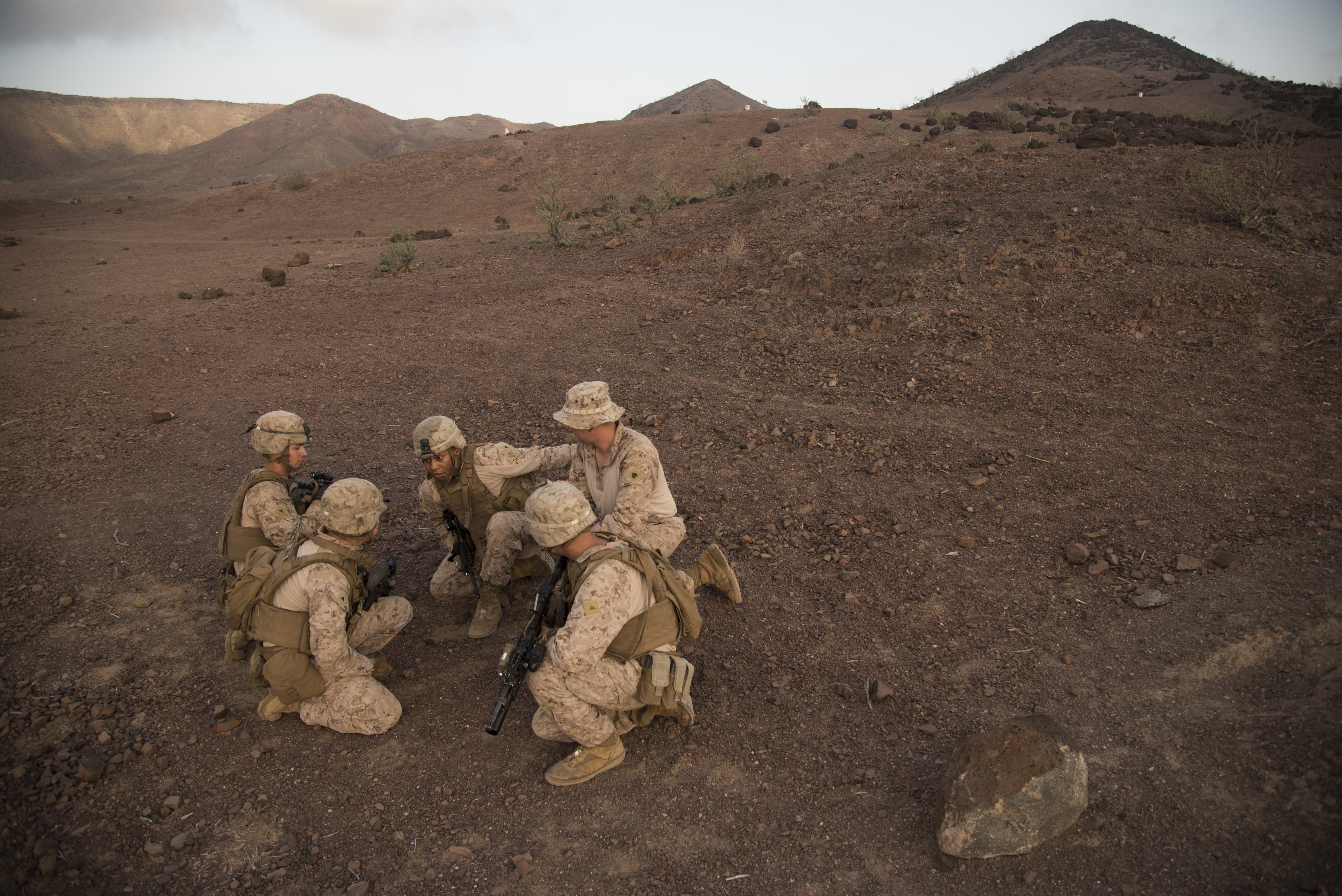 ARTA, Djibouti-U.S. Marines with Special-Purpose Marine Air-Ground Task Force Crisis Response-Africa (SPMAGTF-CR-AF), practice small arms fire team training before the live fire range drill, Oct. 5, 2016, at Arta, Djibouti. Assigned to Combined Joint Task Force-Horn of Africa, SPMAGTF-CR-AF completed team level range drills to continue sustainment of core skills and build from individual skill levels. The next level of training will consist of squad training. (U.S. Air Force photo by Staff Sgt. Tiffany DeNault)