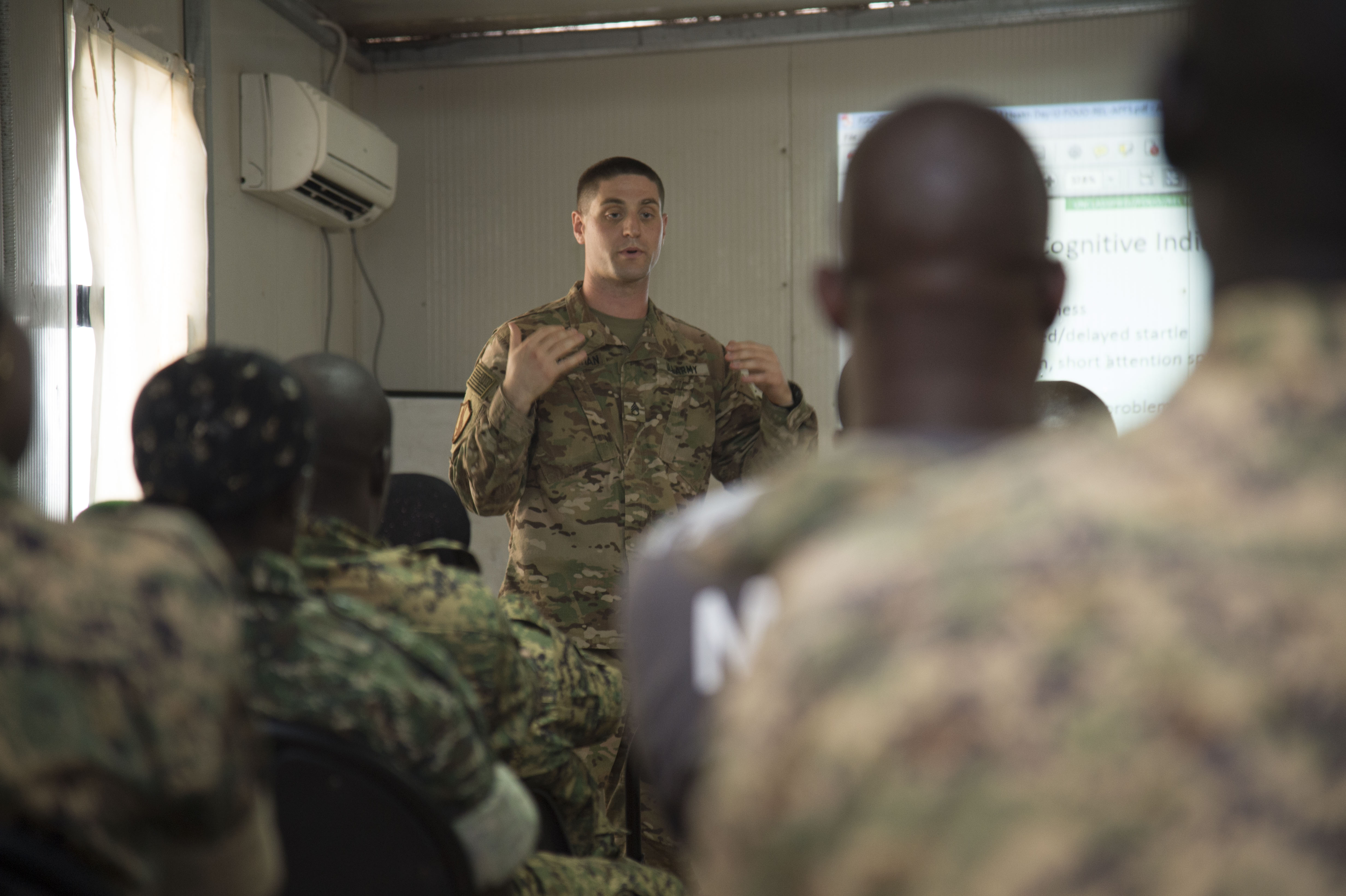 U.S. Army Staff Sgt. Matthew Glaberman, Charlie Company, 411th Civil Affairs Battalion operations sergeant, talks about the effects combat stress can have on a person in a deployed environment, and how to recognize and treat it during a mental health sharing of best practices Oct. 10, 2016, in Mogadishu, Somalia. More than 40 members of the Uganda People's Defense Force attended the class to learn about combat stress while they are deployed in support of the African Union Mission to Somalia. (U.S. Air Force photo by Staff Sgt. Eric Summers Jr.)
