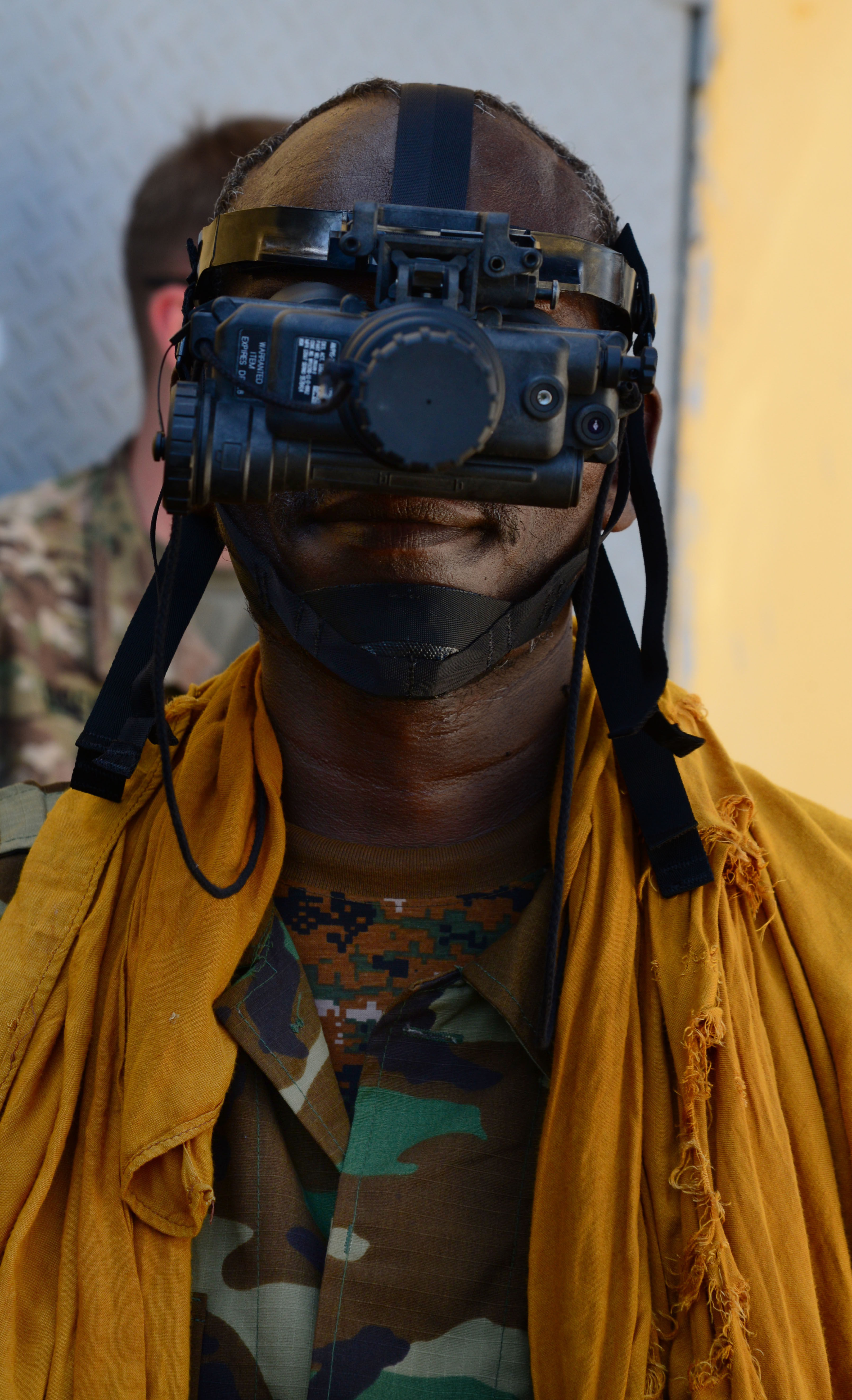 A Djiboutian soldier poses for a photo before taking part in a night vision goggles training exercise in Djibouti City, Oct. 10, 2016. Soldiers learned the components of an NVG kit, accountability, proper wear, usage and tactics such as signaling teammates during the four-day course.  (U.S. Air Force photo by Staff Sgt. Benjamin Raughton)
