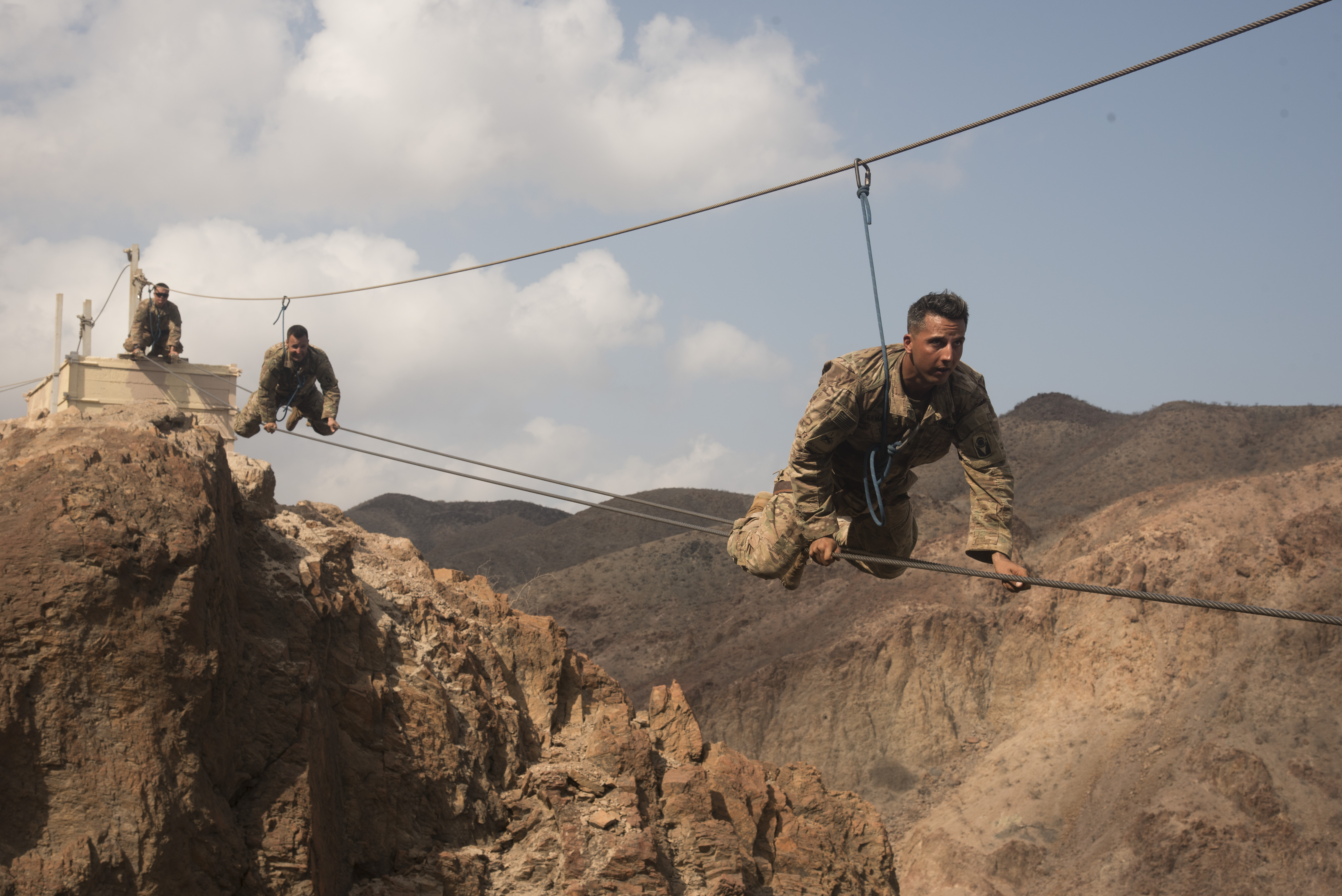 ARTA PLAGE, Djibouti – U.S. Army Soldiers from the 1st Battalion, 124th Infantry Regiment, assigned to Combined Joint Task Force-Horn of Africa, make their way across a portion of the mountain obstacle course, as part of the final day of the French Marines Desert Survival Course, Oct. 10, 2016, at Arta Plage, Djibouti. Approximately 46 U.S. Army Soldiers with French Marines completed several tasks during the survival course, including desert operations, combat lifesaving skills, weapons training, survival cooking, how to decontaminate water, and water and mountain obstacle courses. (U.S. Air Force photo by Staff Sgt. Tiffany DeNault)