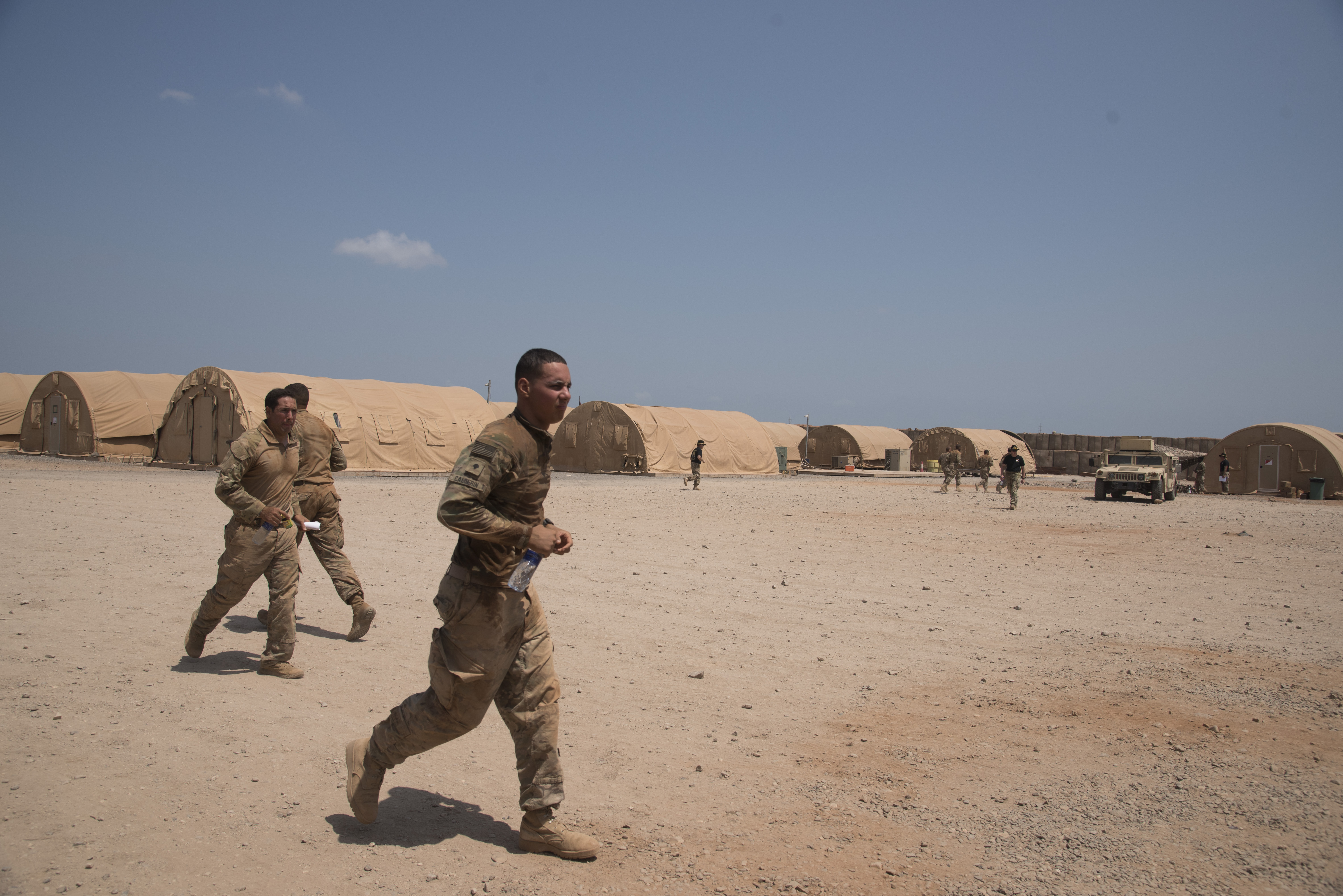 DJIBOUTI- U.S. Army Soldiers with the 1st Squadron, 153rd Cavalry Regiment attached to 1st Battalion, 124th Infantry Regiment, run to their next stress event in an effort to earn their silver spurs as part of a spur ride event, Oct. 21, 2016, at a nearby airfield in Djibouti. The participants completed 10 tasks with various stress events before each task in approximately 19 hours. (U.S. Air Force photo by Staff Sgt. Tiffany DeNault)