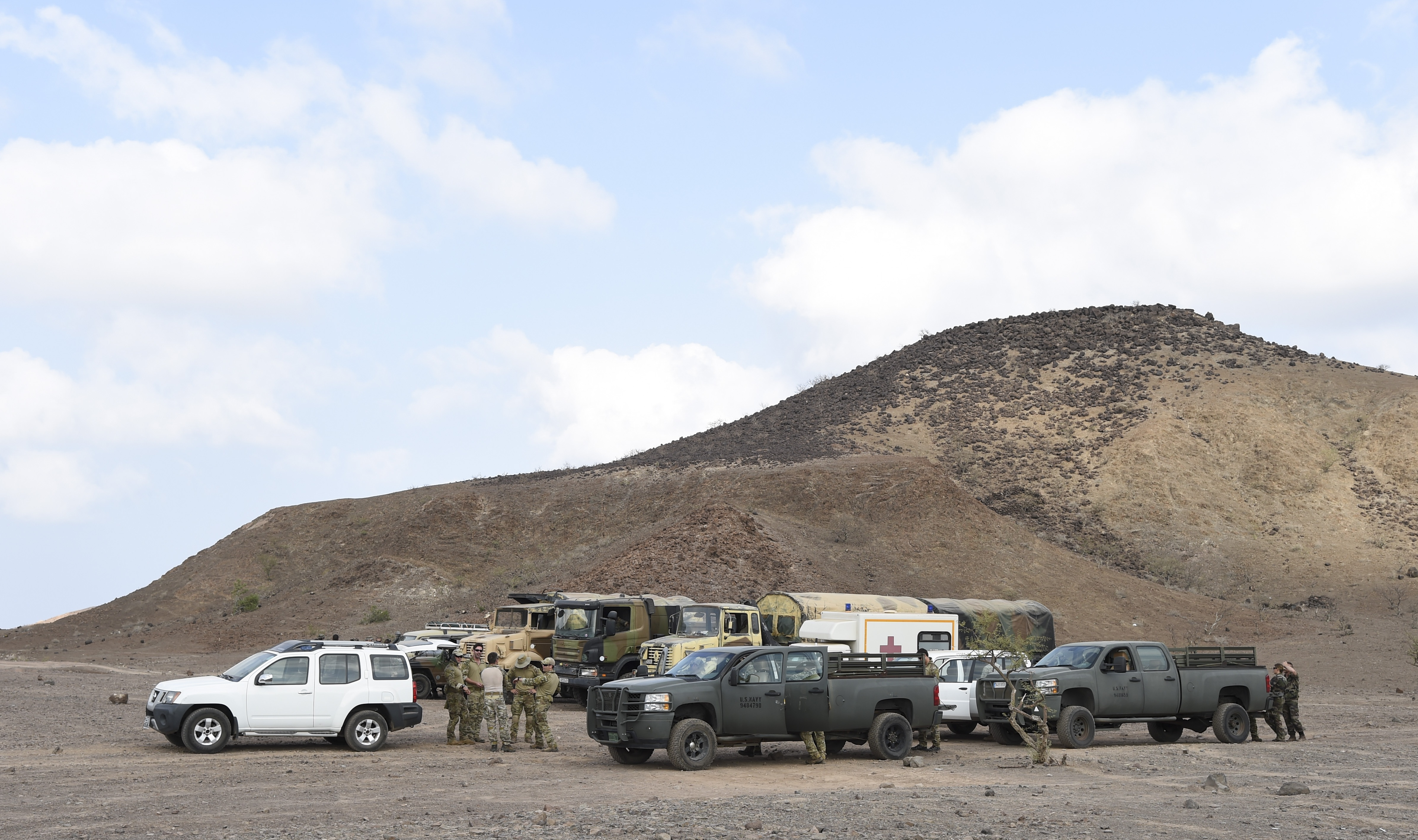 U.S. Navy Sailors with Explosive Ordnance Disposal (EOD) Mobile Unit 6, Task Force Sparta, and French Military EOD personnel gather to coordinate their efforts for the mission, Oct. 22, 2016, in Djibouti. During this operation, Navy and French EOD personnel worked bilaterally to safely clear the range area of unexploded ordnance. (U.S. Air Force photo by Staff Sgt. Penny Snoozy)