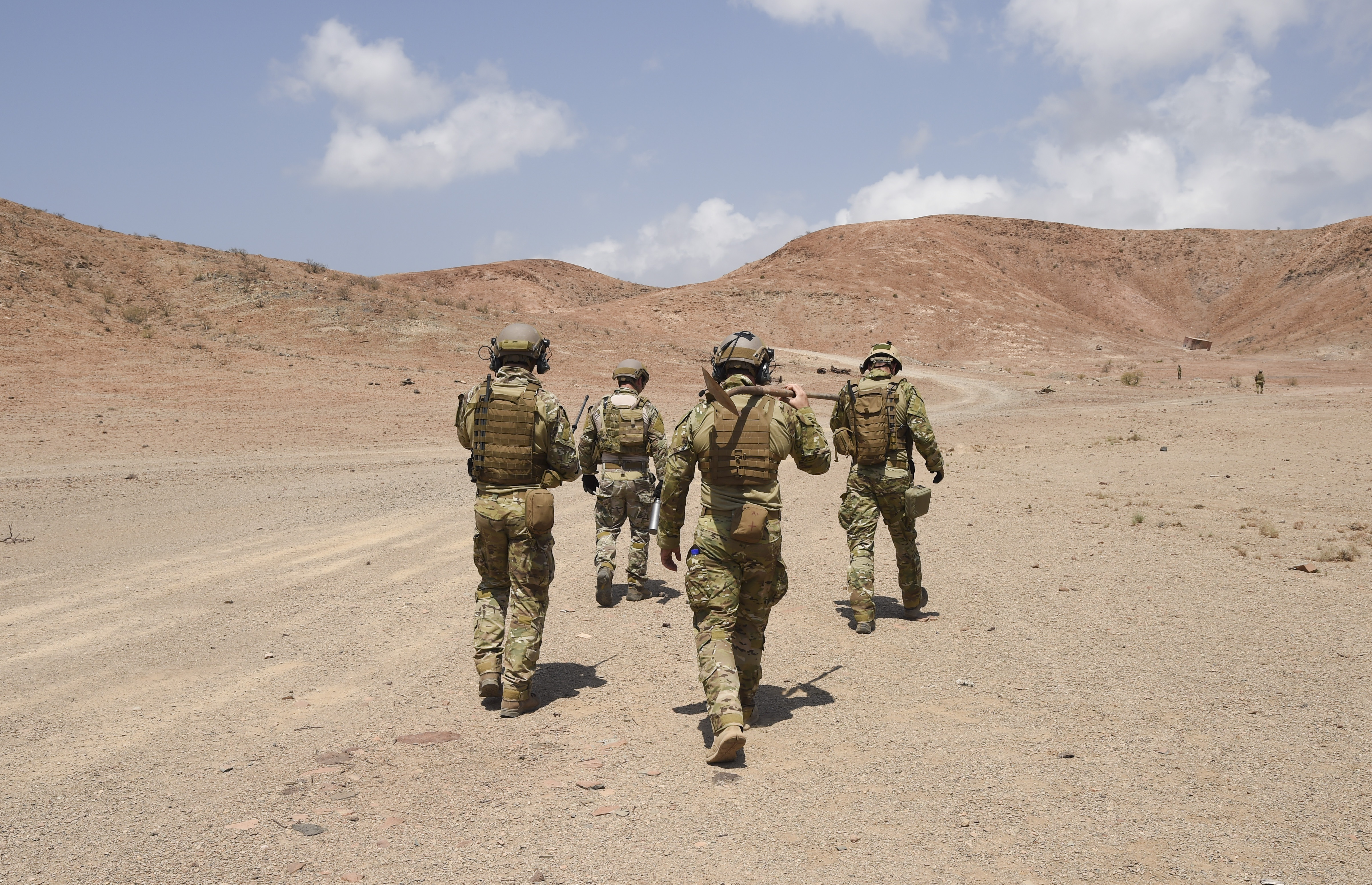 U.S. Navy Sailors with Explosive Ordnance Disposal (EOD) Mobile Unit 6, Task Force Sparta, proceed downrange to a safe area for the remote removal and identification of impacted ordnance, Oct. 22, 2016, in Djibouti. During this operation, Navy and French EOD personnel worked bilaterally to safely clear their respective areas of unexploded ordnance. (U.S. Air Force photo by Staff Sgt. Penny Snoozy)