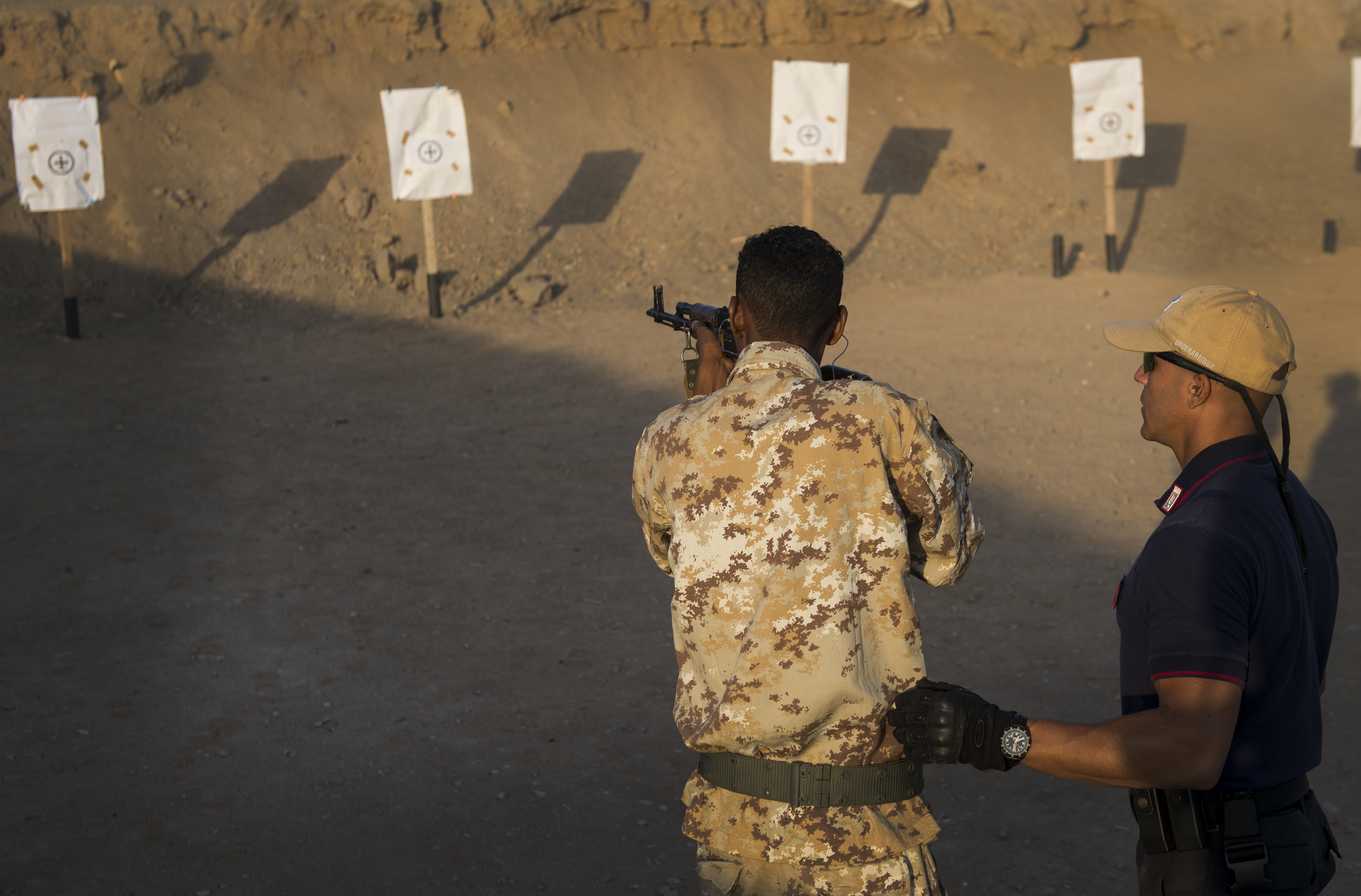 Members of the Carabinieri and Somalia Police Force train at a shooting range in Djibouti, Djibouti, Oct. 30, 2016. The Carabinieri is in charge of training mission MAIDIT Somalia 6, which is the mission of training the Somali Police Force in order to promote the stability and security of the entire region of the Horn of Africa. (U.S. Air Force photo by Staff Sgt. Kenneth W. Norman)