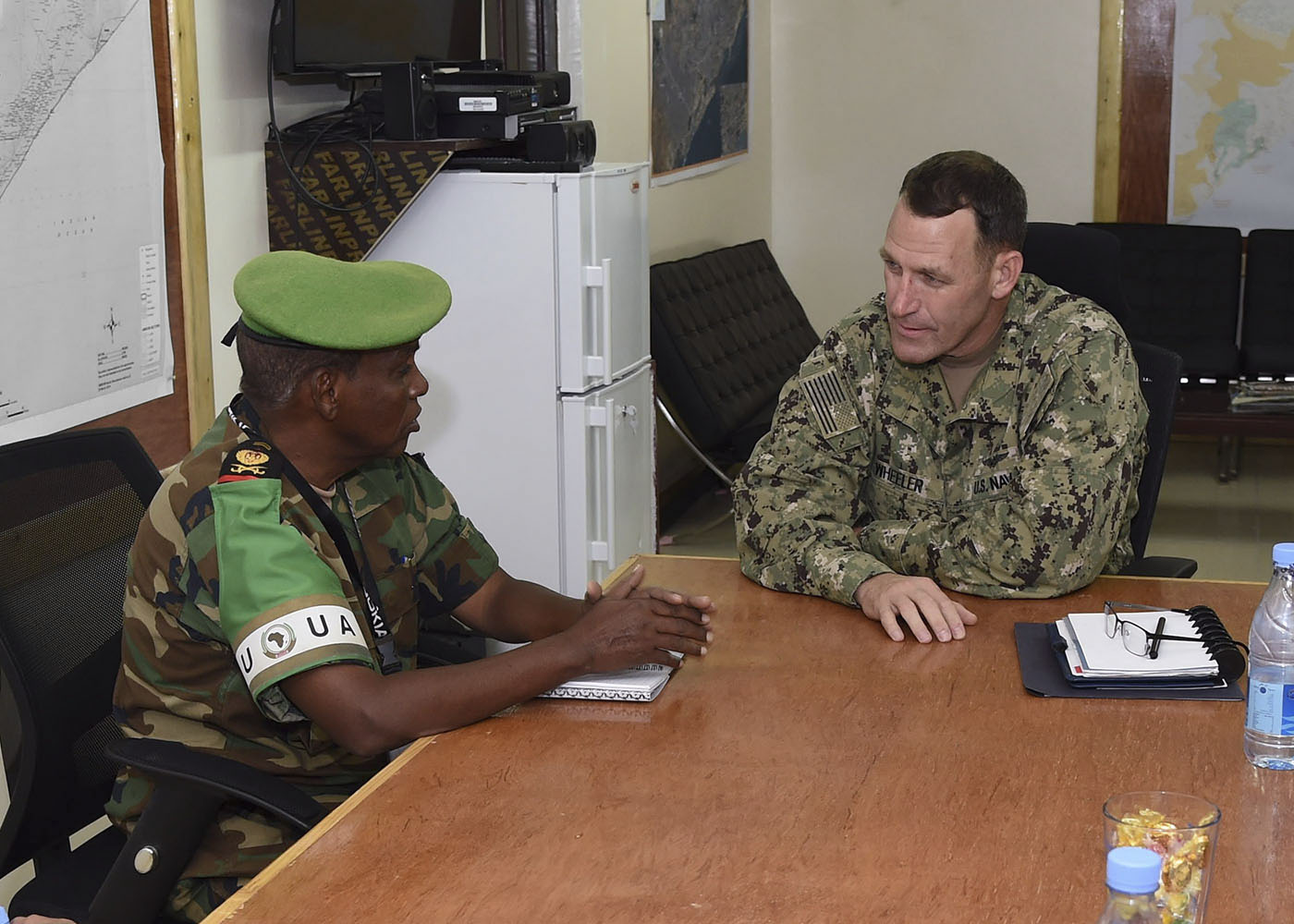 Lt. Gen. Osman Soubagleh, the force commander of African Union Mission in Somalia (AMISOM) and U.S. Navy Rear Adm. William Wheeler III, deputy commander of Combined Joint Task Force-Horn of Africa (CJTF-HOA), engage in discussion in the Military Coordination Cell conference room, Nov. 2, 2016, in Mogadishu, Somalia. The venue allowed members to discuss security situations, AMISOM challenges, and the current dynamics seen by both sides. These meetings align with the CJTF-HOA mission of supporting and enabling the stabilization of Somalia. (U.S. Air Force photo illustration by Staff Sgt. Penny Snoozy)