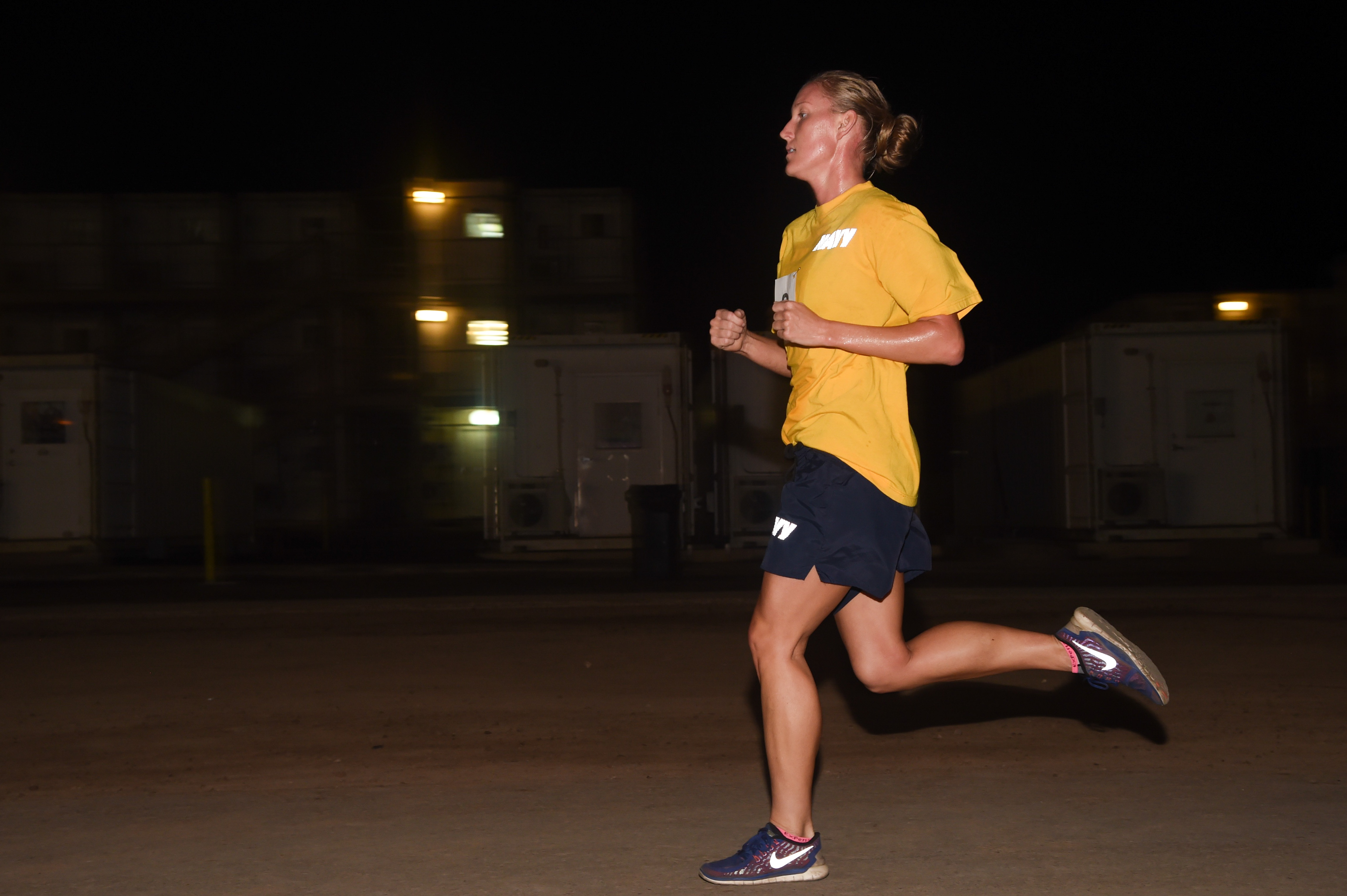 U.S. Navy Lt. j.g. Christina Hammervold, Task Force Sparta platoon commander, sprints her two-mile run graded to Army standards during the Joint Warrior Competition, Nov. 19, 2016, Camp Lemonnier, Djibouti. The run began after participants had already completed pull-ups, sit-ups, and push-ups. Members involved in the event met on the turf field at 3:30 a.m. to begin the day of events. (U.S. Air National Guard photo by Staff Sgt. Penny Snoozy)