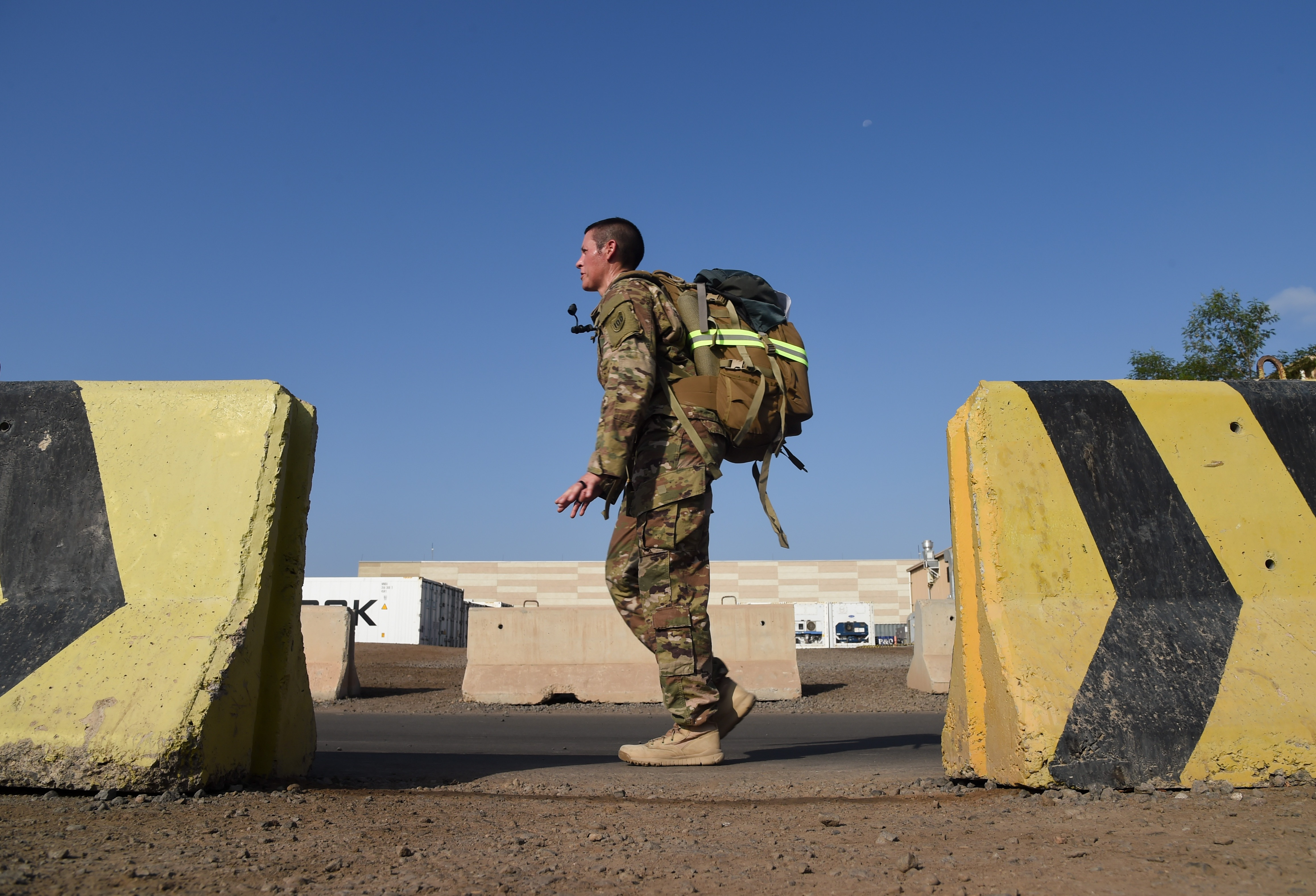 U.S. Army Staff Sgt. Hannah Mabel, Combined Joint Task Force-Horn of Africa, endures a five-mile Army ruck march during the Joint Warrior Competition, Nov. 19, 2016, Camp Lemonnier, Djibouti. The ruck march began after participants had already completed a. Competitors had to carry a minimum of 35 pounds during the march. (U.S. Air National Guard photo by Staff Sgt. Penny Snoozy)