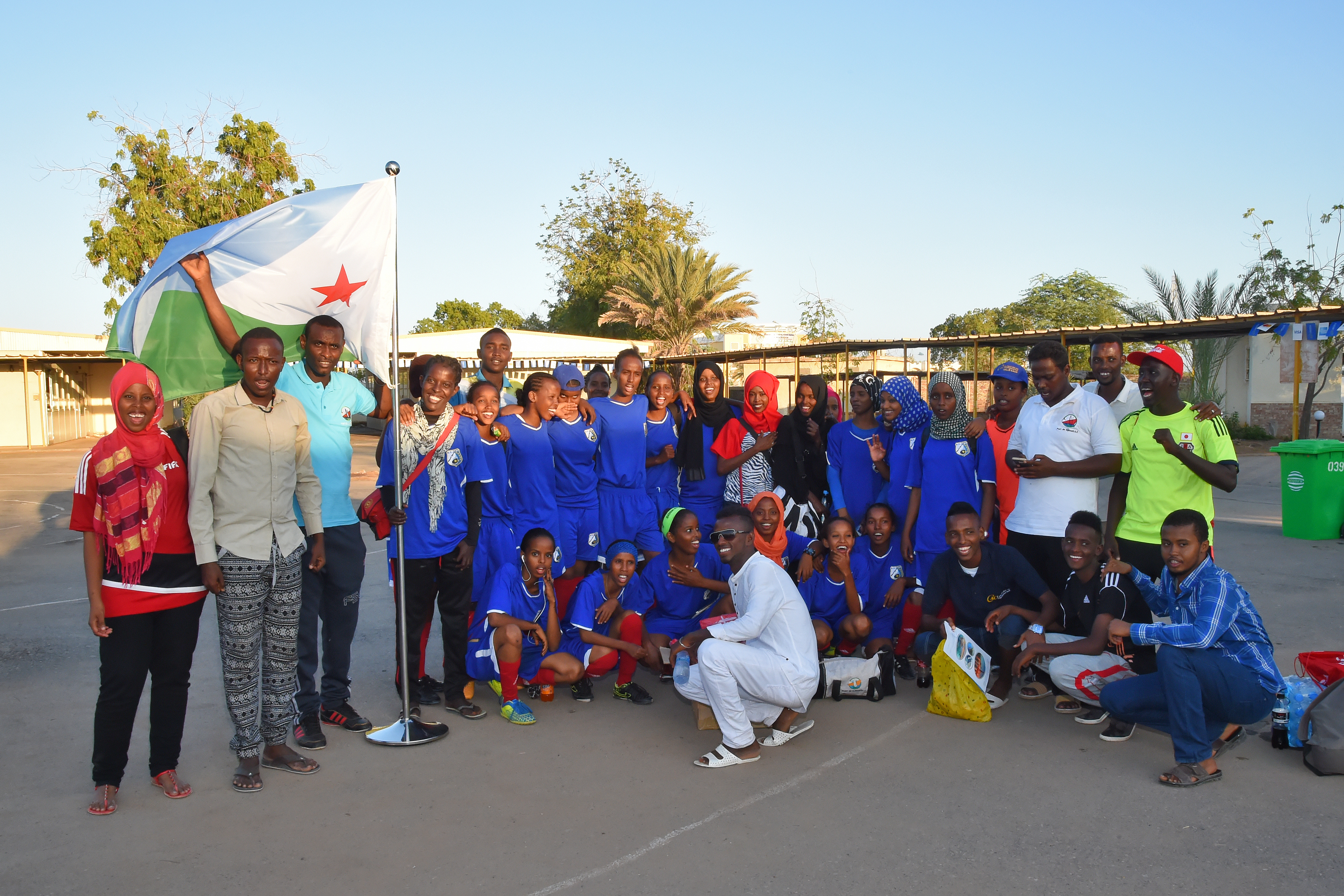 A women's soccer team from Djibouti City gather with friends at the French school Kessel in downtown Djibouti Dec. 9, 2016 following a friendly soccer tournament supporting the Kick for Nick Foundation. The non-profit foundation was established in 2006 by the family of Pfc. Nicholas Madaras, an avid soccer player and youth coach who was killed while serving in Iraq. (U.S. Air National Guard photo by Master Sgt. Paul Gorman)