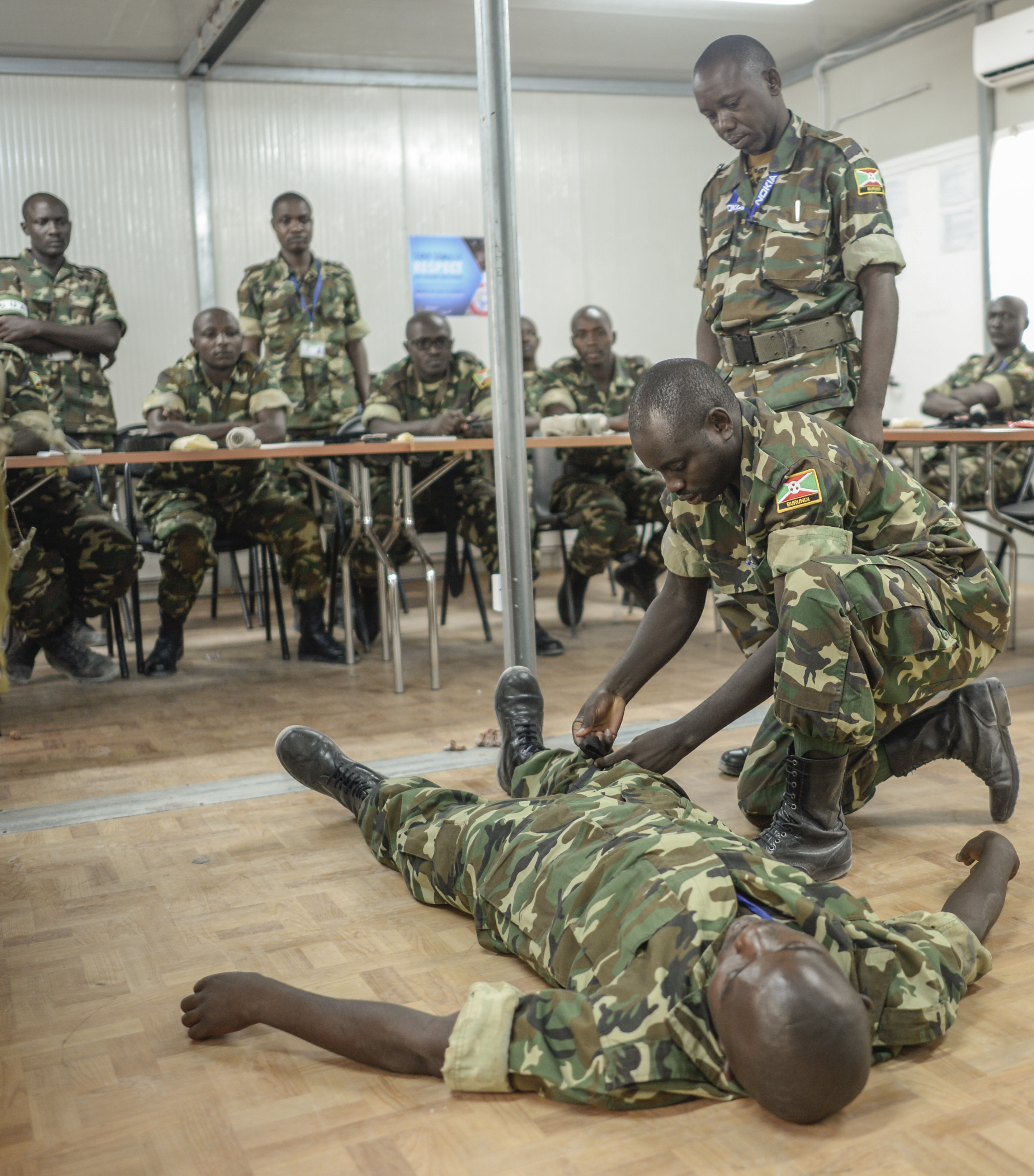 MOGADISHU, SOMALIA- Burundi military personnel demonstrate skills learned during a first response medical course facilitated by the United Nations in Somalia, Dec. 19, 2016. The U. N. course curriculum is intended to standardize medical support techniques during peacekeeping operations and political missions in the field.
