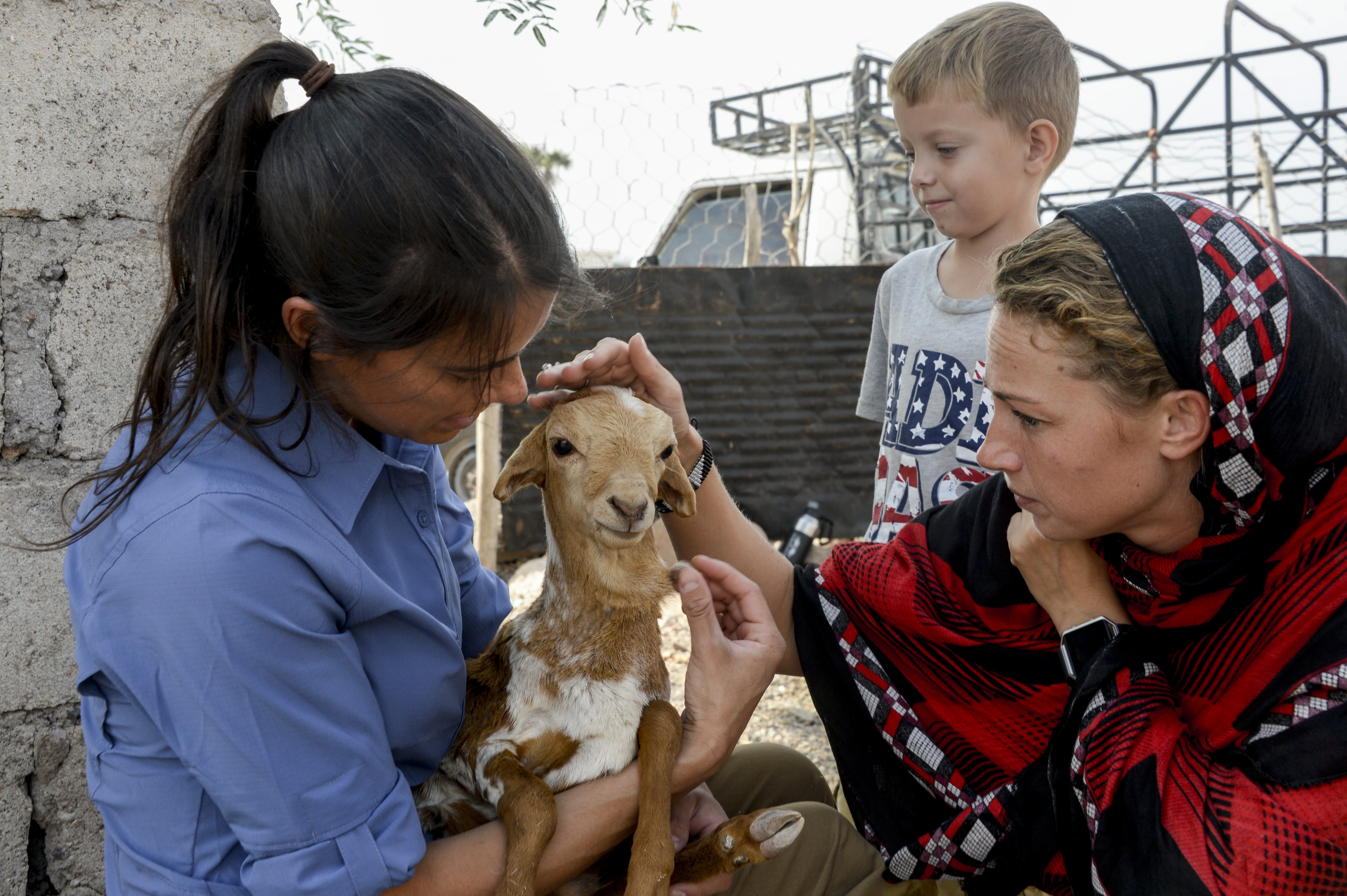 U.S. Army Capt. Kika Straub, civil affairs veterinary field officer, and U.S. Army Sgt. Sarah Dearcy, civil affairs medical specialist, examine a young goat in a village near Tadjourah, Djibouti, Dec. 15, 2016.  U.S. Army Civil Affairs teams identify critical requirements needed by local citizens while fostering and maintaining dialogue with civilian aid agencies and assistance organizations. (U.S. Air National Guard photo by Staff Sgt. Christian Jadot)