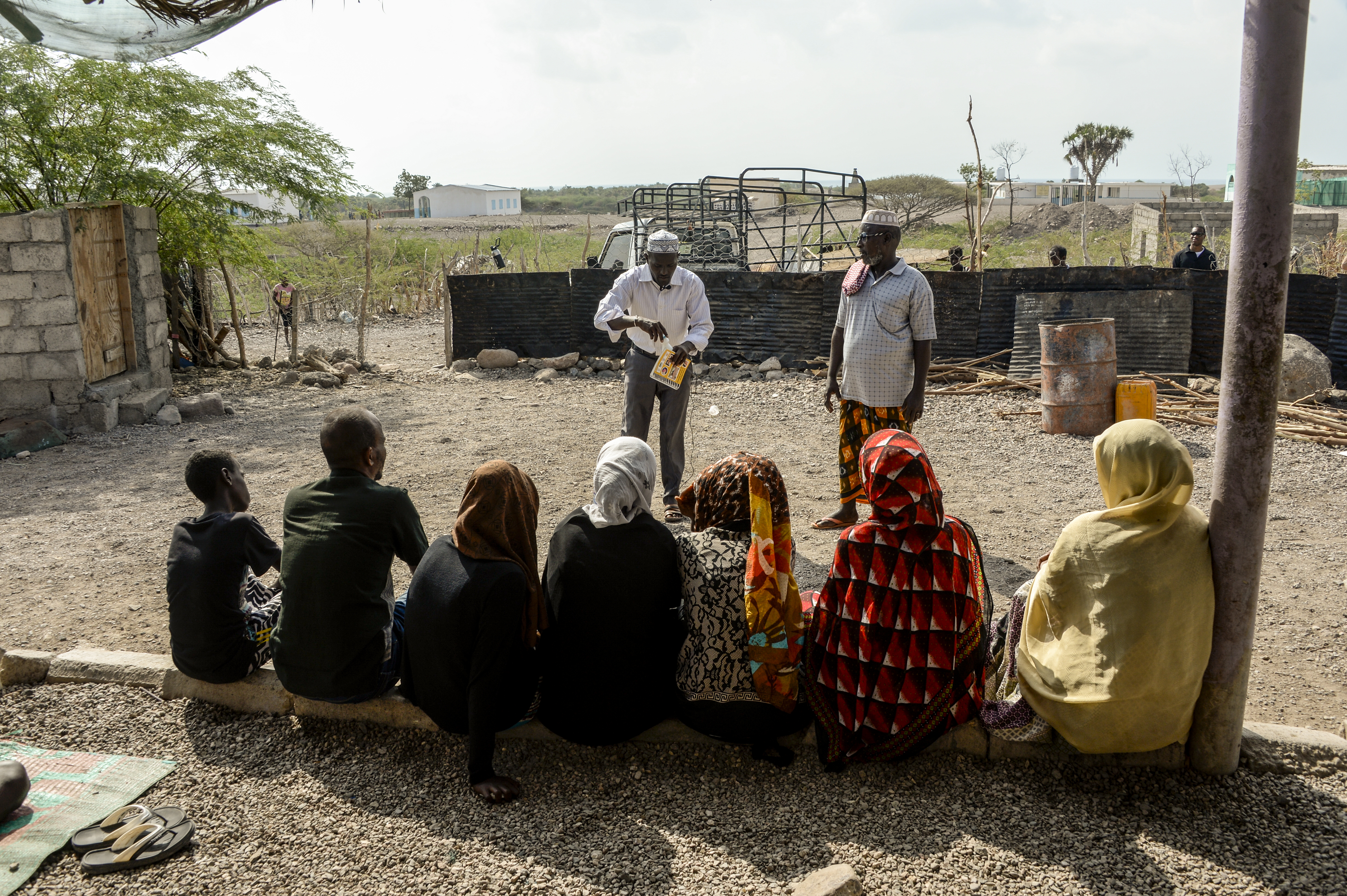 "The cast of ""Ahmed the Herder"" and a local clan leader rehearse an upcoming scene in a village near Tadjourah, Djibouti, Dec. 15, 2016.  ""Ahmed the Herder"" is a video series that teaches best practices in animal health care, and is facilitated by U.S. Army civil affairs personnel for the International Development and Relief Board. (U.S. Air National Guard photo by Staff Sgt. Christian Jadot)"