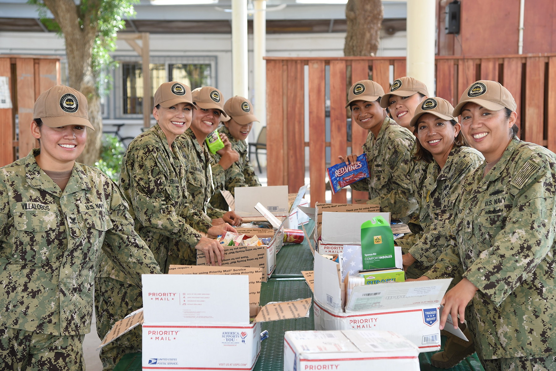 U.S. Navy Coastal Riverine Squadron 11 members are all smiles after receiving care packages for female service members, Dec. 17, 2016, at Camp Lemonnier, Djibouti. The Religious Affairs Office received 12 packages from the Mission Beach Women's Club in San Diego and distributed them to the service members in CRS 11. The CRS 11 Sailors patrol the local port to protect high-value-assets. (U.S. Air National Guard photo by Staff Sgt. Penny Snoozy)