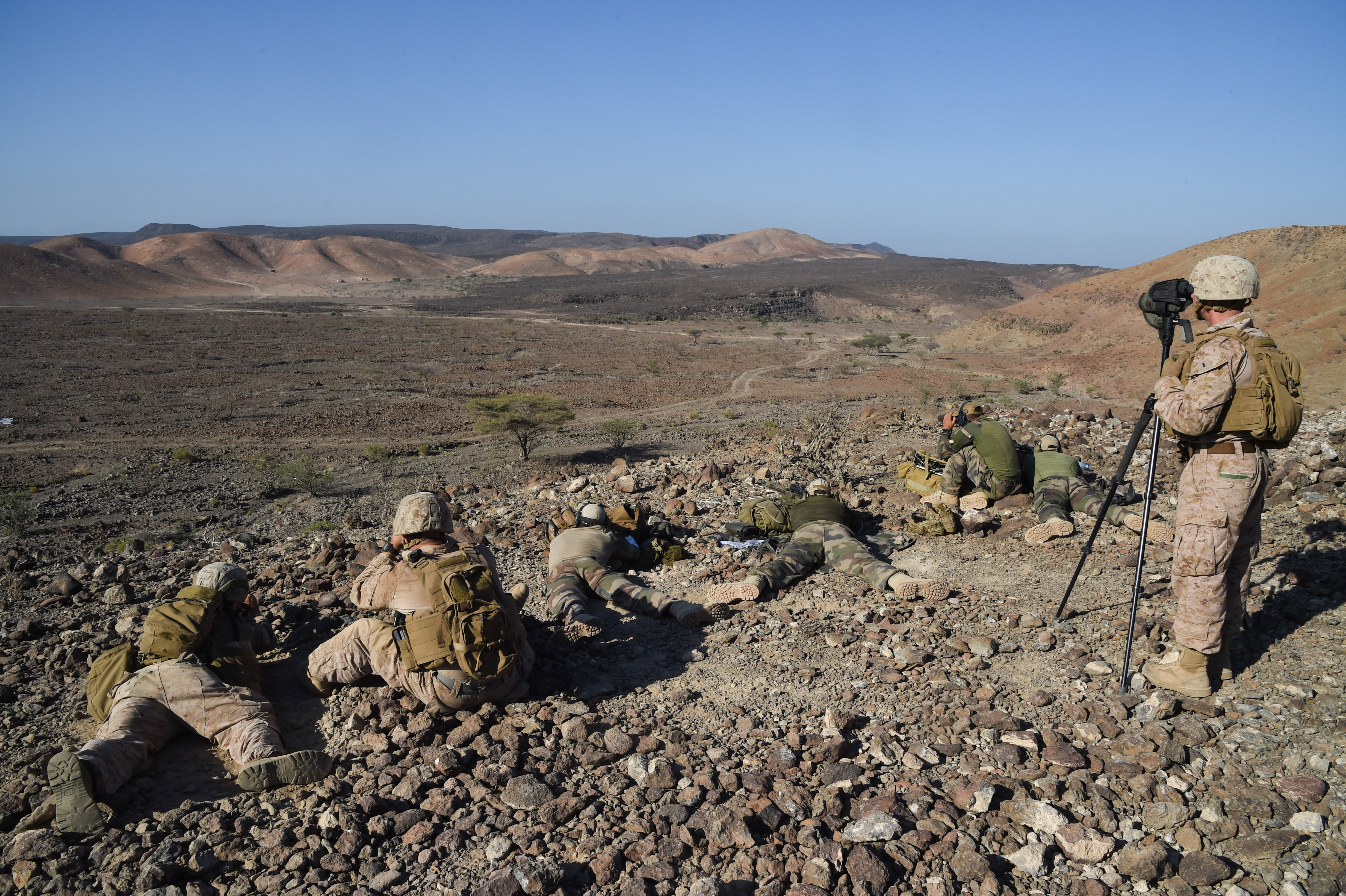 U.S. Marine Corps members with Scout Sniper Platoon, Battalion Landing Team 1st Battalion, 4th Marines, 11th Marine Expeditionary Unit (MEU), focus downrange during exercise Alligator Dagger, Dec. 13, 2016, at Arta Plage, Djibouti. The unknown distance course was part of bilateral training with the 3rd Infantry French Marines Sniper Platoon. The exercise allows opportunities for the 11th MEU to maintain their respective skills and proficiencies. (U.S. Air National Guard photo by Staff Sgt. Penny Snoozy)