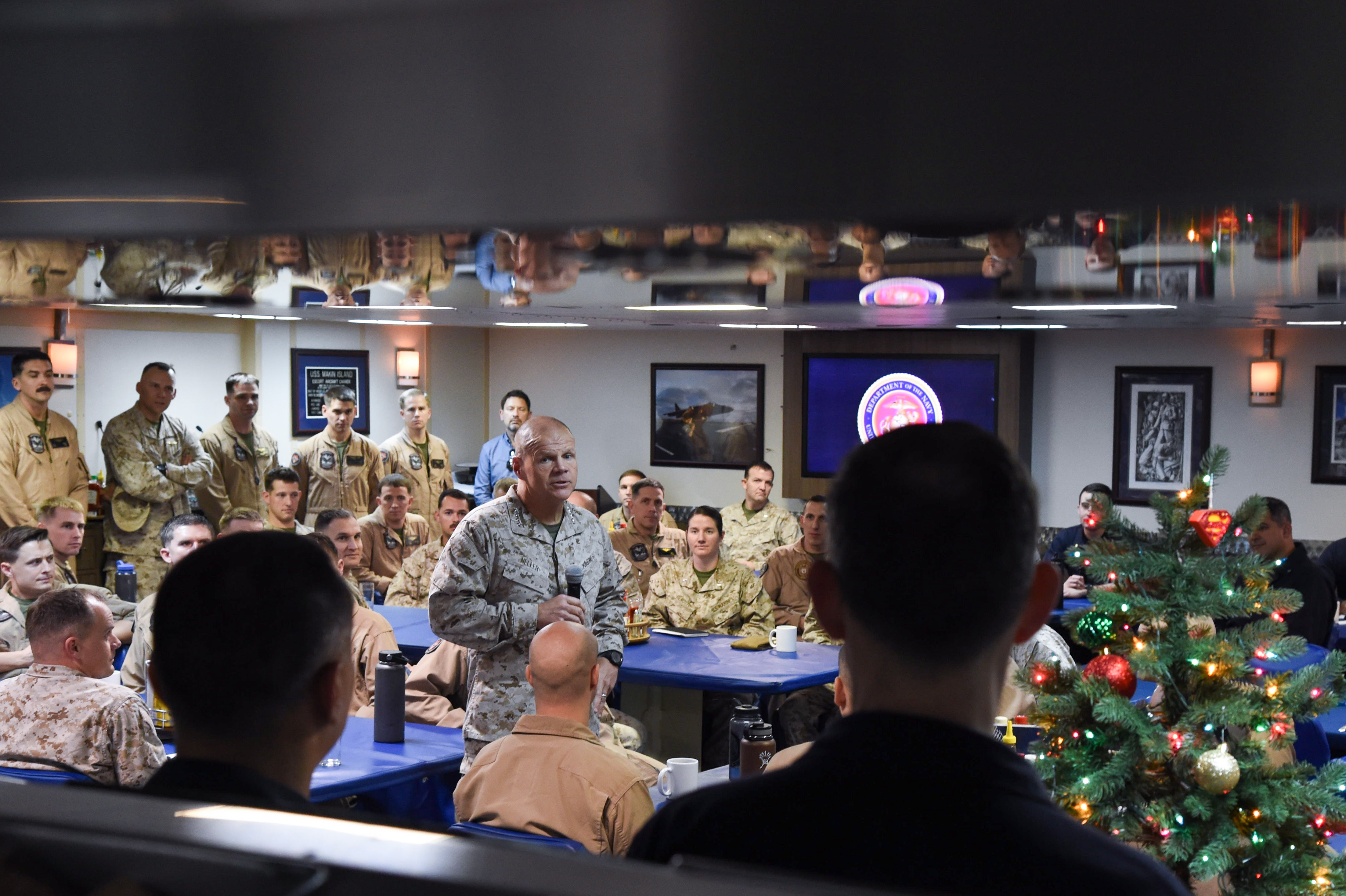 U.S. Marine Corps Gen. Robert B. Neller, 37th Commandant of the Marine Corps, speaks to Marines with the 11th Marine Expeditionary Unit and Sailors assigned to the amphibious assault ship USS Makin Island (LHD 8), in the Gulf of Aden, Dec. 23, 2016. A MEU is a forward-deployed, flexible sea-based Marine air-ground task force ready to respond to crisis and conduct limited contingency operations. (U.S. Air National Guard photo by Staff Sgt. Penny Snoozy)