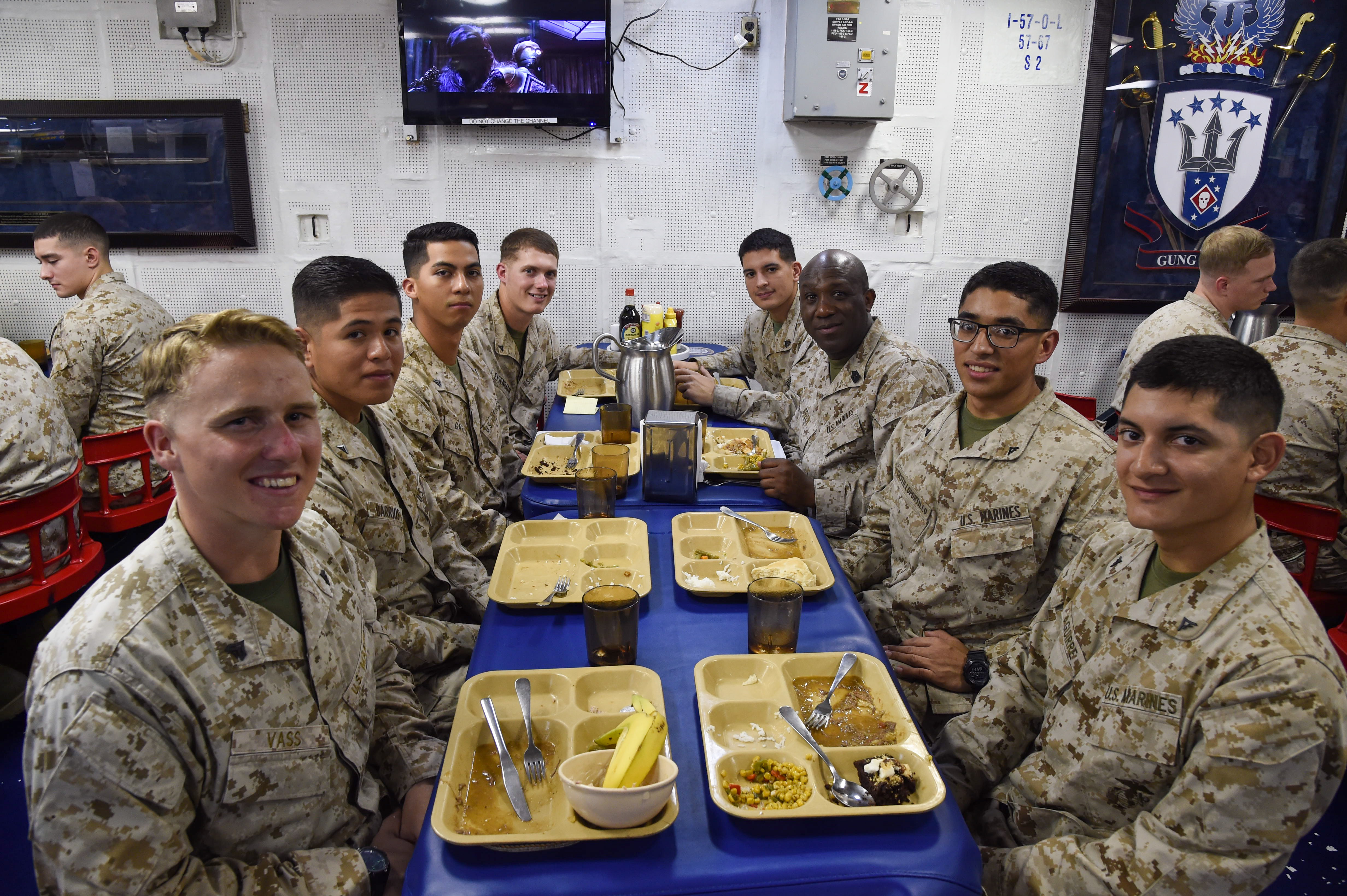 Sgt. Maj. Ronald Green, Sergeant Major of the Marine Corps, speaks to Marines with the 11th Marine Expeditionary Unit assigned to the amphibious assault ship USS Makin Island (LHD 8), during lunch aboard the Makin Island, in the Gulf of Aden, Dec. 23, 2016. A MEU is a forward-deployed, flexible sea-based Marine air-ground task force ready to respond to crisis and conduct limited contingency operations. (U.S. Air National Guard photo by Staff Sgt. Penny Snoozy)