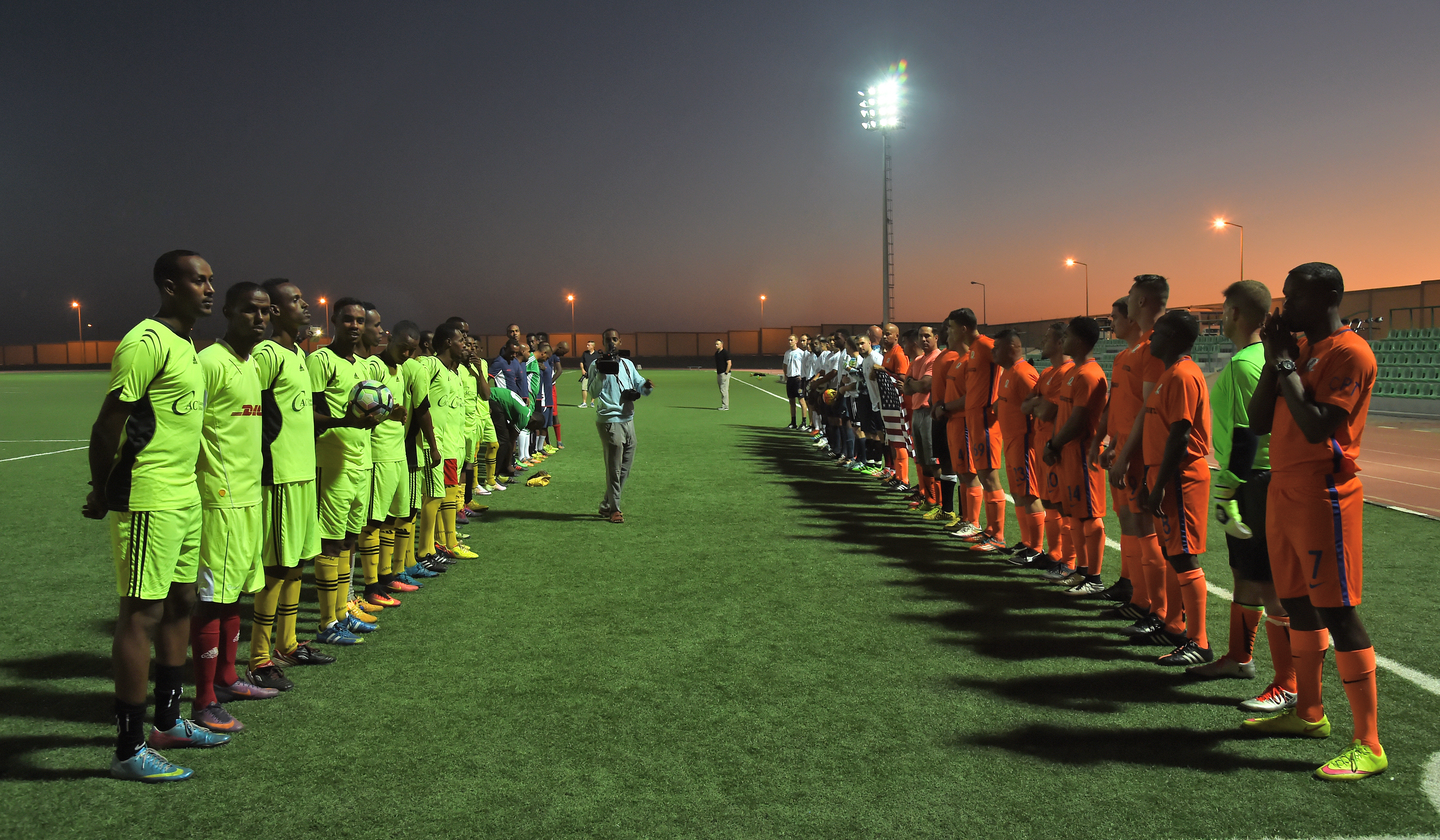 Teams comprised of U.S. military members stationed at Camp Lemonnier, and members of the Djibouti Armed Forces (FAD) Republican Guard face off for the first in a series of friendly soccer matches at the Balbala Sports Complex in Djibouti City, Jan. 1, 2017. Through the organization of regular sporting events, the U.S. service members strive to strengthen the relationship with their FAD counterparts as well as with partner nation militaries operating in the Horn of Africa.  (U.S. Air National Guard photo by Master Sgt. Paul Gorman)