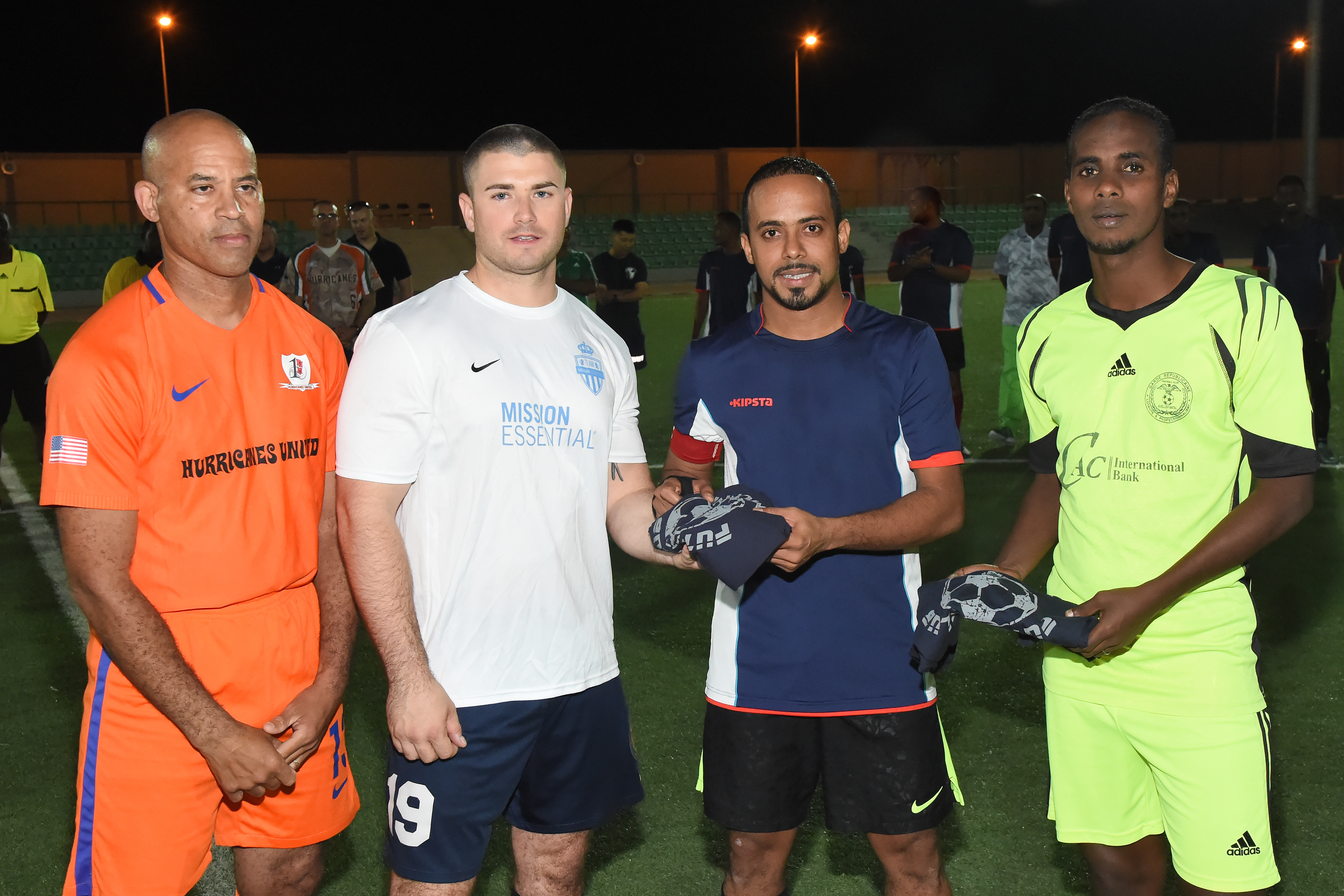 Teams comprised of U.S. military members stationed at Camp Lemonnier, and members of the Djibouti Armed Forces (FAD) Republican Guard exchange gifts prior to the first in a series of friendly soccer matches at the Balbala Sports Complex in Djibouti City, Jan. 1, 2017. Through the organization of regular sporting events, the U.S. service members strive to strengthen the relationship with their FAD counterparts as well as with partner nation militaries operating in the Horn of Africa.  (U.S. Air National Guard photo by Master Sgt. Paul Gorman)
