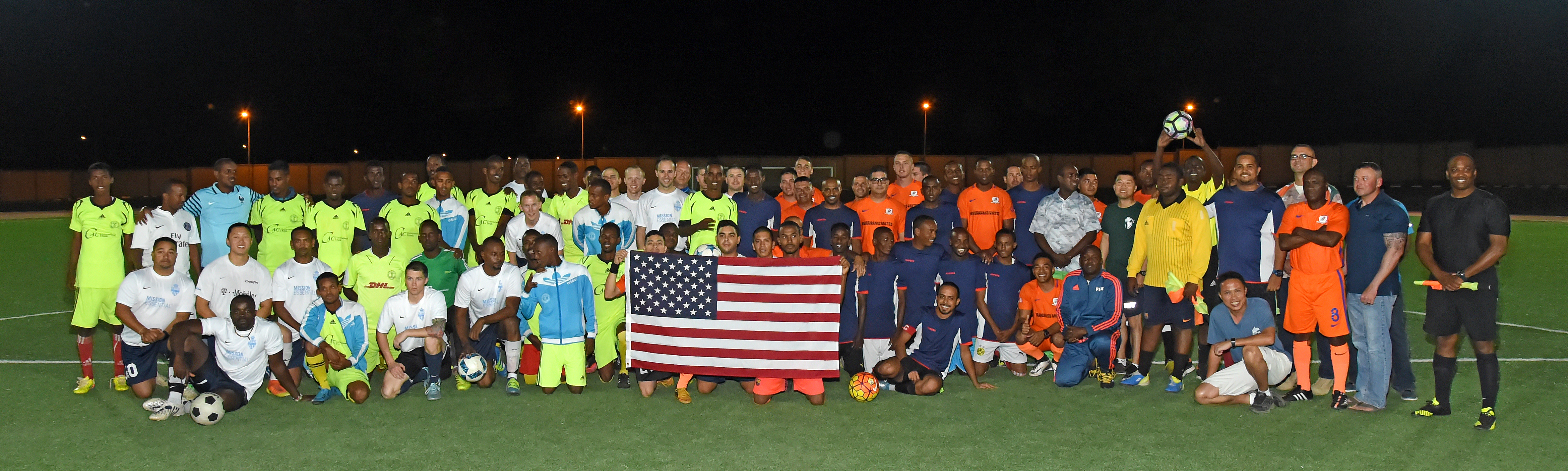 Teams comprised of U.S. military members stationed at Camp Lemonnier, and members of the Djibouti Armed Forces (FAD) Republican Guard gather for a group photo prior to the first in a series of friendly soccer matches at the Balbala Sports Complex in downtown Djibouti Jan. 1, 2017. Through the organization of regular sporting events, the U.S. service members strive to strengthen the relationship with their FAD counterparts as well as with partner nation militaries operating in the Horn of Africa.  (U.S. Air National Guard photo by Master Sgt. Paul Gorman)