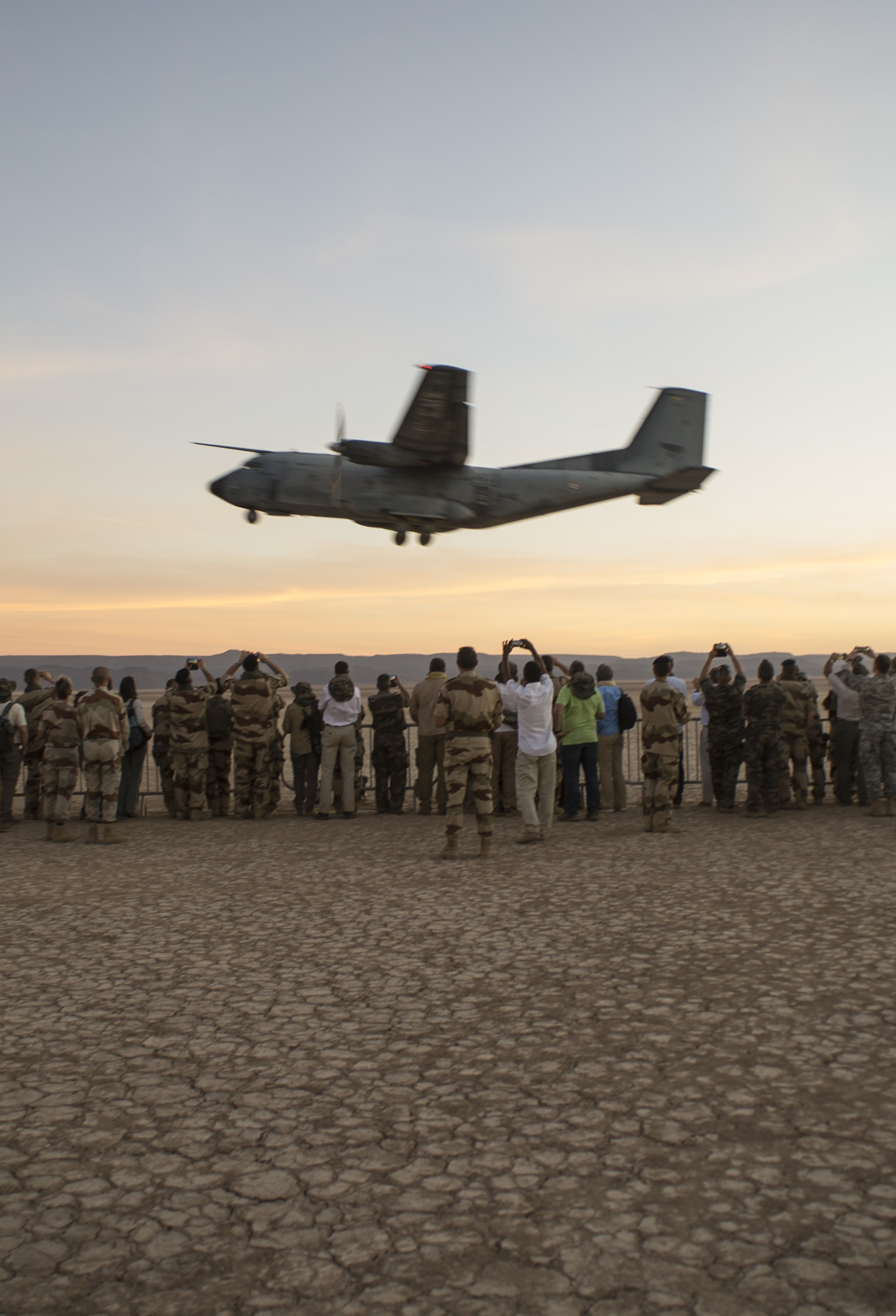 A French C-160 Transall transport aircraft takes off in front of a crowd of onlookers during the French live fire demonstration near Grand Bara, Djibouti, Jan. 14, 2017. The C-160 Transall is a tactical transport aircraft capable of carrying up to 93 troops with the ability to take off on an airstrip as short as 700 meters. (U.S. Air National Guard photo by:  Staff Sgt. Christian Jadot)