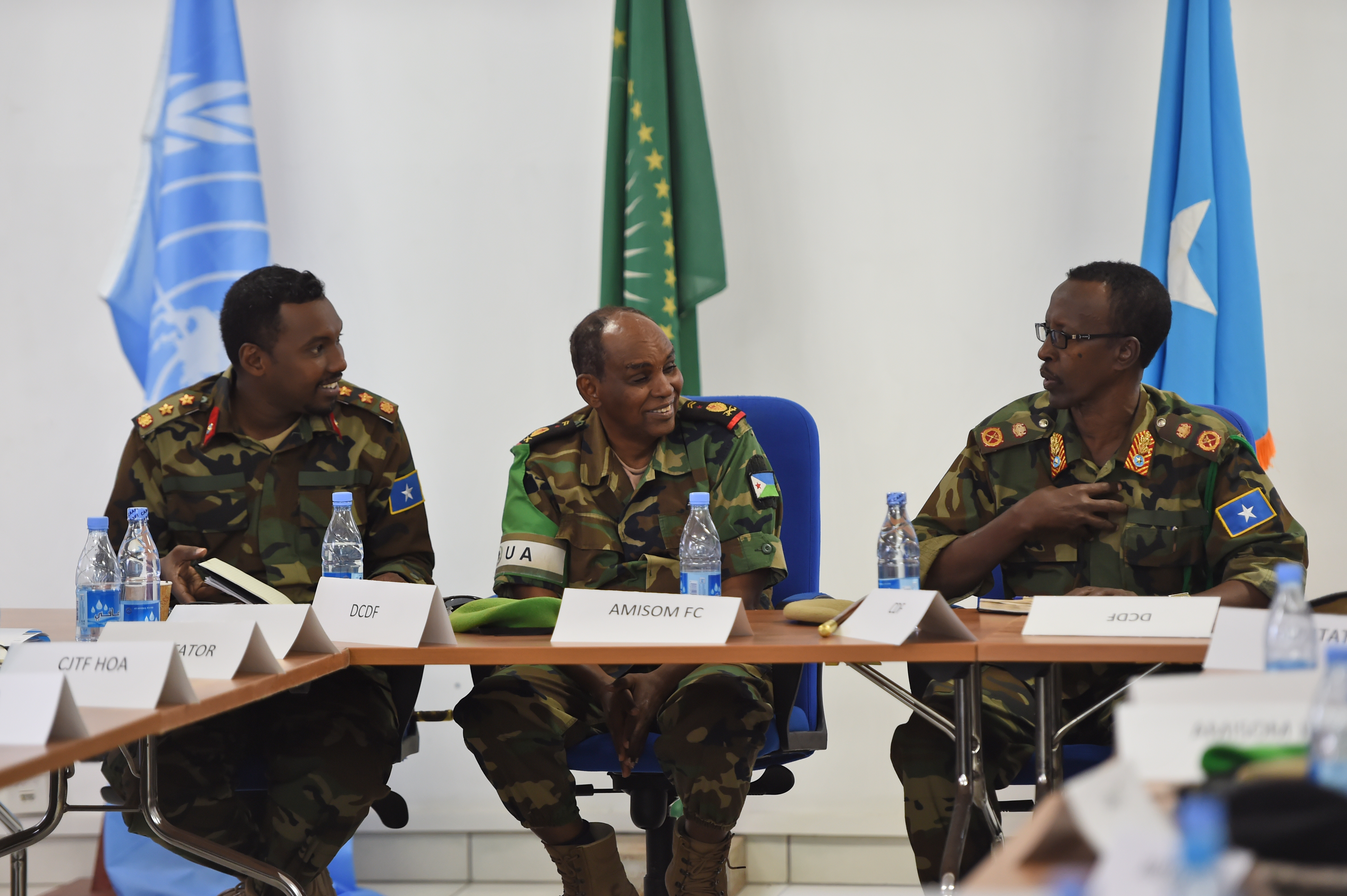 Somali National Army Chief of Defense Forces Maj. Gen. Mohammed Adan Ahmed, right, and Chief of Staff Col. Ahmed Mohammed, left, converse with African Union Mission in Somalia Force Commander Lt. Gen. Osman Noor Soubagleh during the SNA Symposium in downtown Mogadishu, Jan. 12, 2017. The symposium is part of an ongoing international effort to aid security conditions throughout Somalia by fostering the growth and revitalization of the national military defense force, which disbanded following the collapse of the country's central government in 1991.