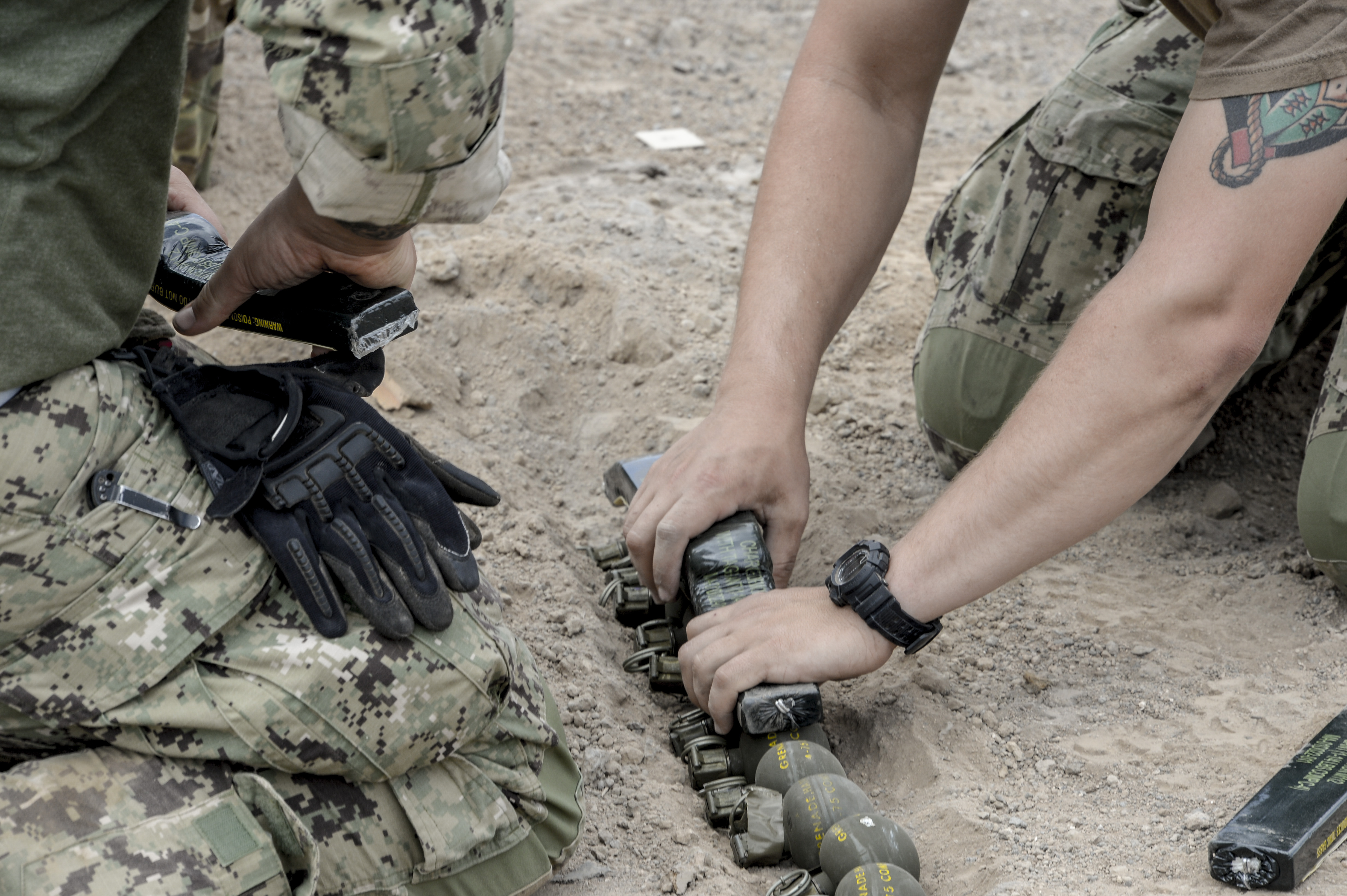 U.S. Navy Sailors of Combined Joint Task Force Horn of Africa Explosive Ordnance Disposal (EOD) members, use C-4 explosives on defective hand-grenades to dispose of them safely and properly at Arta Plage, Djibouti, Jan. 30, 2017. EOD teams disarm active improvised explosive devices in deployed areas around the globe. (U.S. Air National Guard photo by Staff Sgt. Christian Jadot)