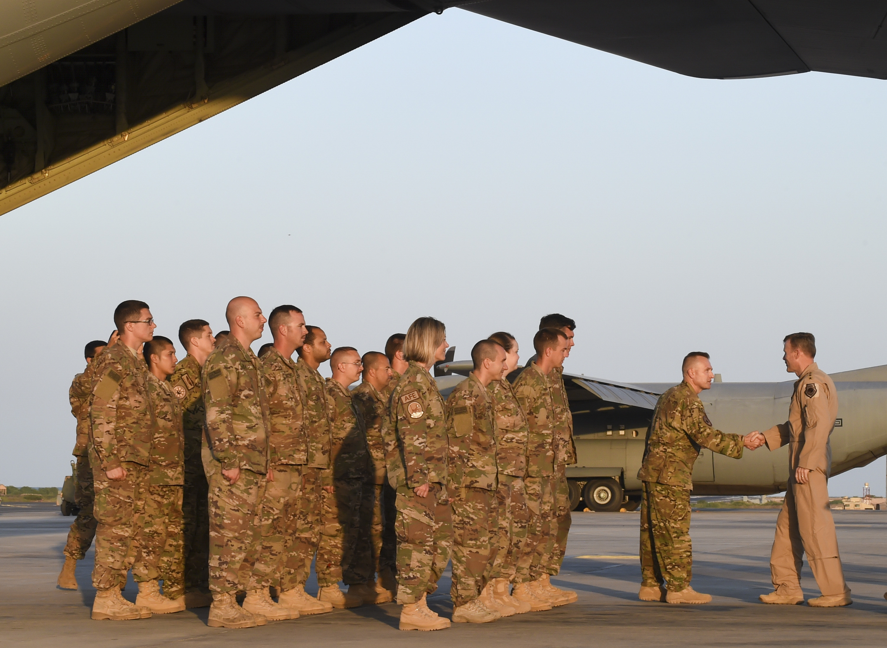 U.S. Air Force Gen. Tod Wolters, commander U.S. Air Forces in Europe and Air Forces Africa (USAFE-AFAFRICA), greets members of the 75th Expeditionary Airlift Squadron and U.S. Air Force joint terminal attack controllers at Camp Lemonnier, Djibouti, Feb. 1, 2017. Wolters visited with U.S. Air Force members in Djibouti to gain insight into the integrated missions and hear about the roles of Airmen in the joint environment. The members assembled nearby their respective aircraft, a C-130J Super Hercules during this portion of the USAFE-AFAFRICA commander's visit.