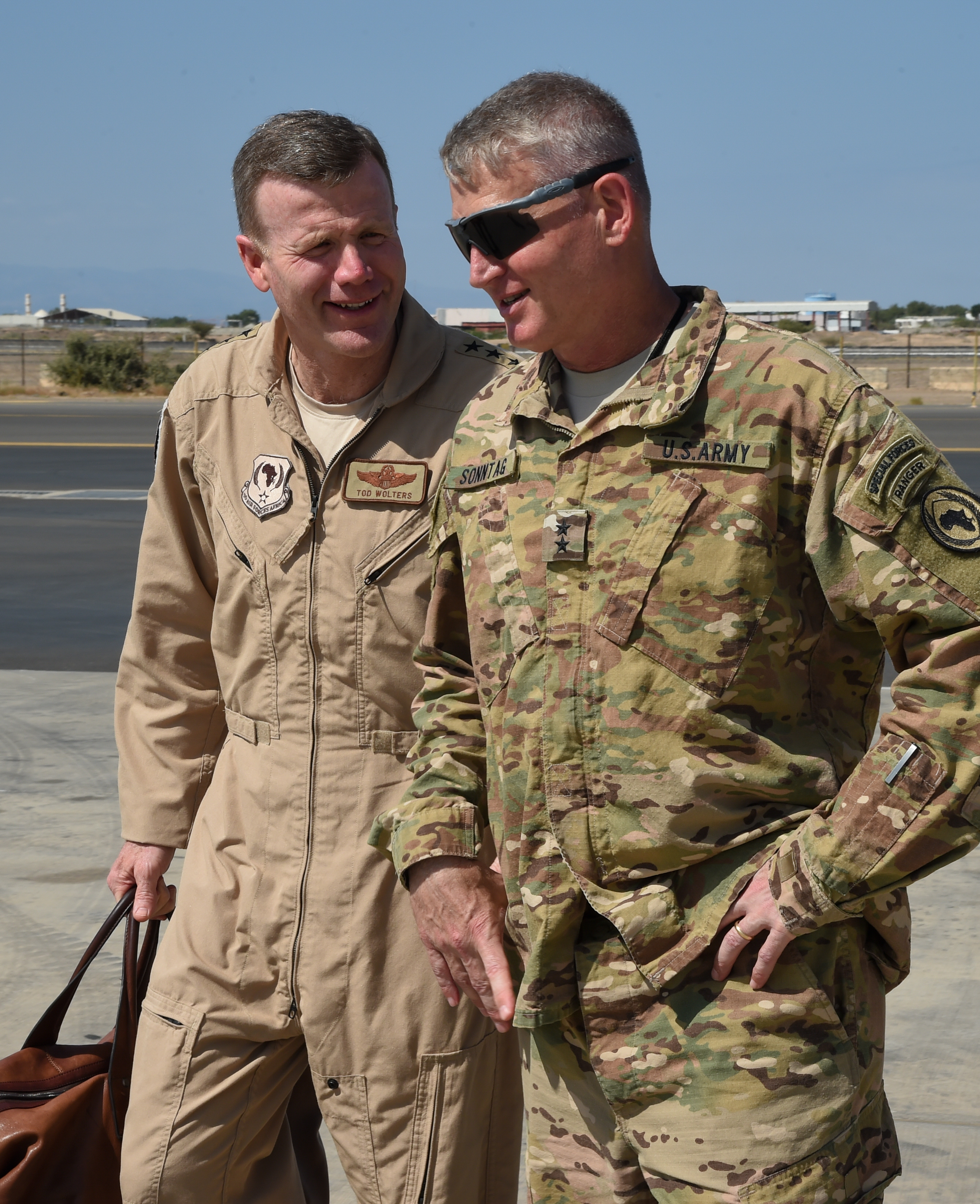 U.S. Air Force Gen. Tod Wolters, commander of U.S. Air Forces in Europe and Air Forces Africa (USAFE-AFAFRICA), walks with Maj. Gen. Kurt Sonntag, commander of Combined Joint Task Force-Horn of Africa, after his arrival at Camp Lemonnier, Djibouti, Feb. 1, 2017. One of the USAFE-AFAFRICA responsibilities is enabling NATO pledged Air Forces and supporting the peace and stability of African states. (U.S. Air National Guard photo by Staff Sgt. Penny Snoozy)