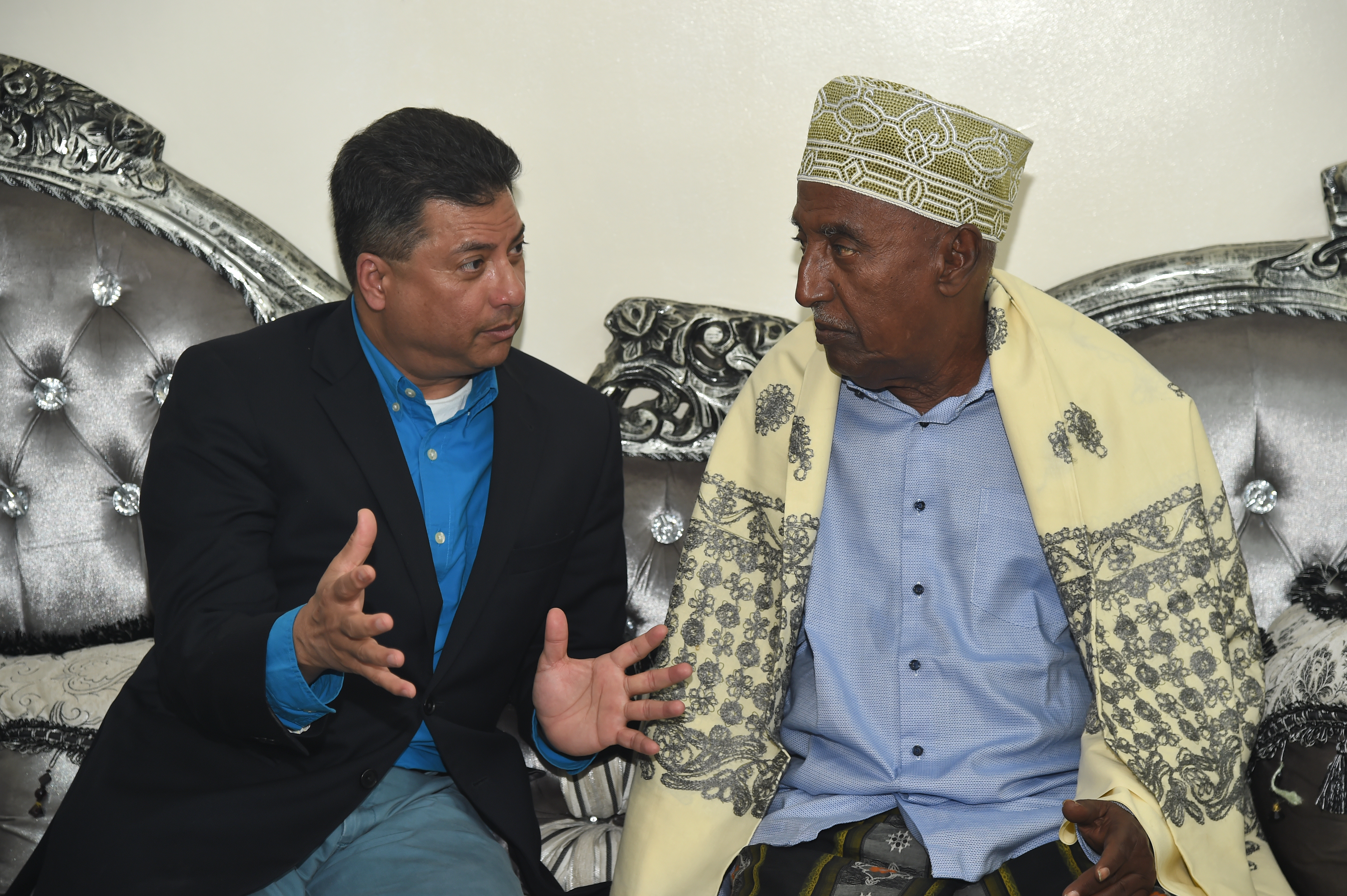 U.S. Navy Cmdr. Abuhena Saifulislam, deputy command chaplain for U.S. Africa Command, describes Muslim life in America to Abdelkader Mohamed Humad, Sultan of Tadjoura during a visit to Tadjoura, Djibouti Jan. 30, 2017. The meeting was part of a week-long temporary duty assignment to Djibouti for exercise Cutlass Express 2017, during which Saifulislam was able to engage with key Muslim leaders and local practitioners of the Islamic faith. (U.S. Air National Guard photo by Master Sgt. Paul Gorman)