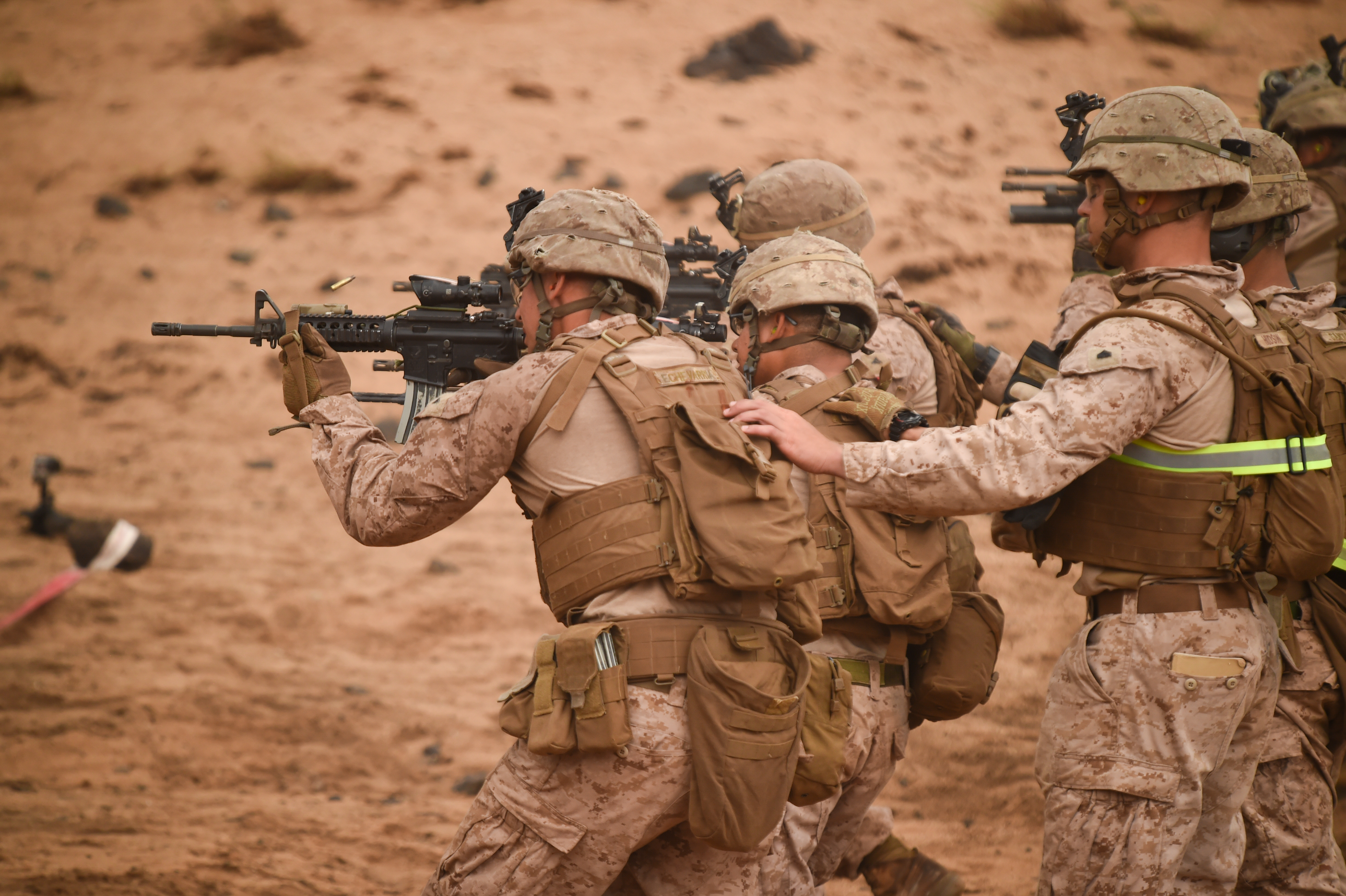 U.S. Marines with Alpha Company, 1st Battalion, 11th Marine Expeditionary Unit (MEU), move downrange while being guided during a Combat Marksmanship Program shoot, Feb. 14, 2017, at Arta Beach in Djibouti. Marines worked on accurately engaging a target while moving and under physical stress. A MEU is a forward-deployed, flexible sea-based Marine air-ground task force ready to respond to crisis and conduct limited contingency operations. (U.S. Air National Guard photo by Staff Sgt. Penny Snoozy)