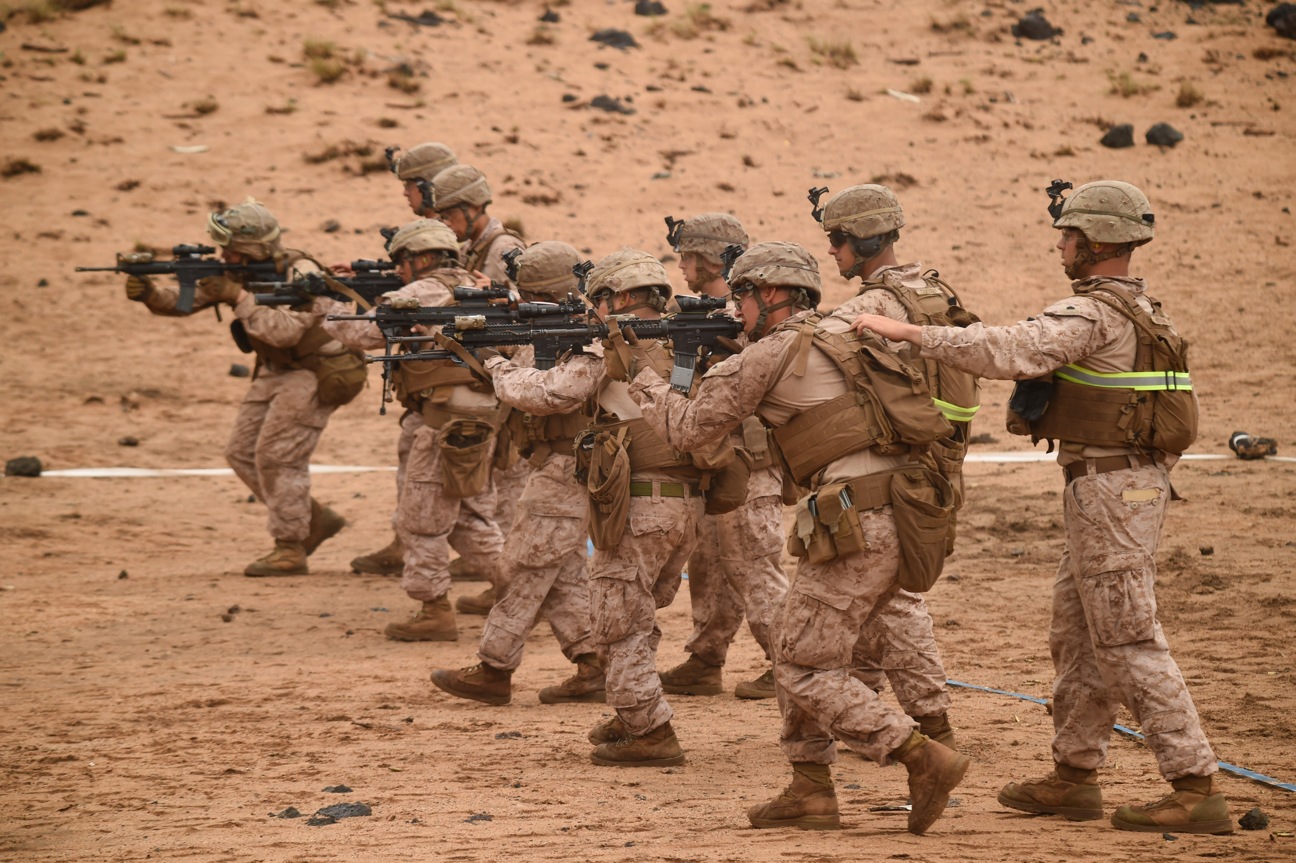 U.S. Marines with Alpha Company, 1st Battalion, 11th Marine Expeditionary Unit (MEU), move downrange while being guided during a Combat Marksmanship Program shoot, Feb. 14, 2017, at Arta Beach in Djibouti. Marines worked on engaging a target while moving and under physical stress. The time on the range allows the 11th MEU to maintain their respective skills and proficiencies. (U.S. Air National Guard photo by Staff Sgt. Penny Snoozy)