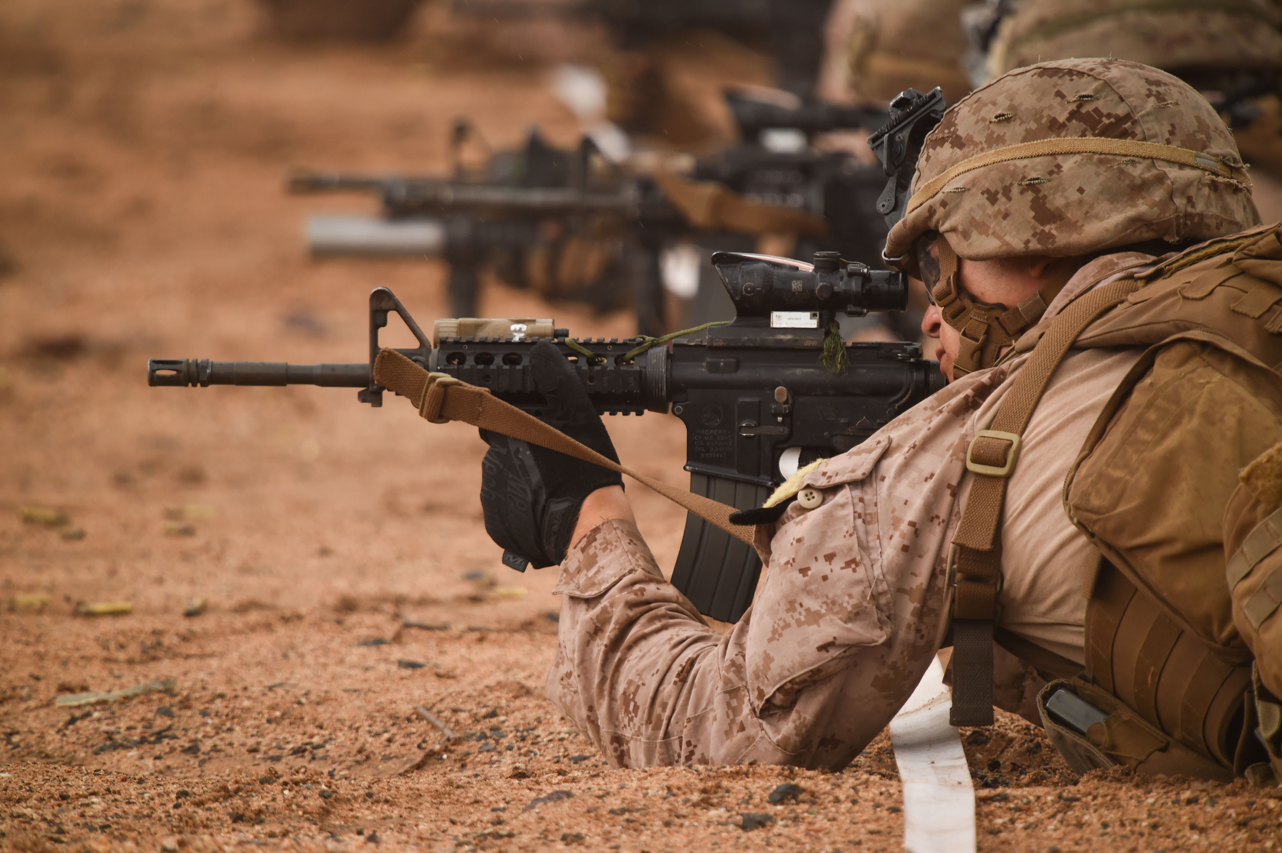 U.S. Marines with Alpha Company, 1st Battalion, 11th Marine Expeditionary Unit (MEU), focus downrange in a prone position during a Combat Marksmanship Program shoot, Feb. 14, 2017, at Arta Beach in Djibouti. Marines worked on engaging a target while moving and under physical stress. A MEU is a forward-deployed, flexible sea-based Marine air-ground task force ready to respond to crisis and conduct limited contingency operations. (U.S. Air National Guard photo by Staff Sgt. Penny Snoozy)
