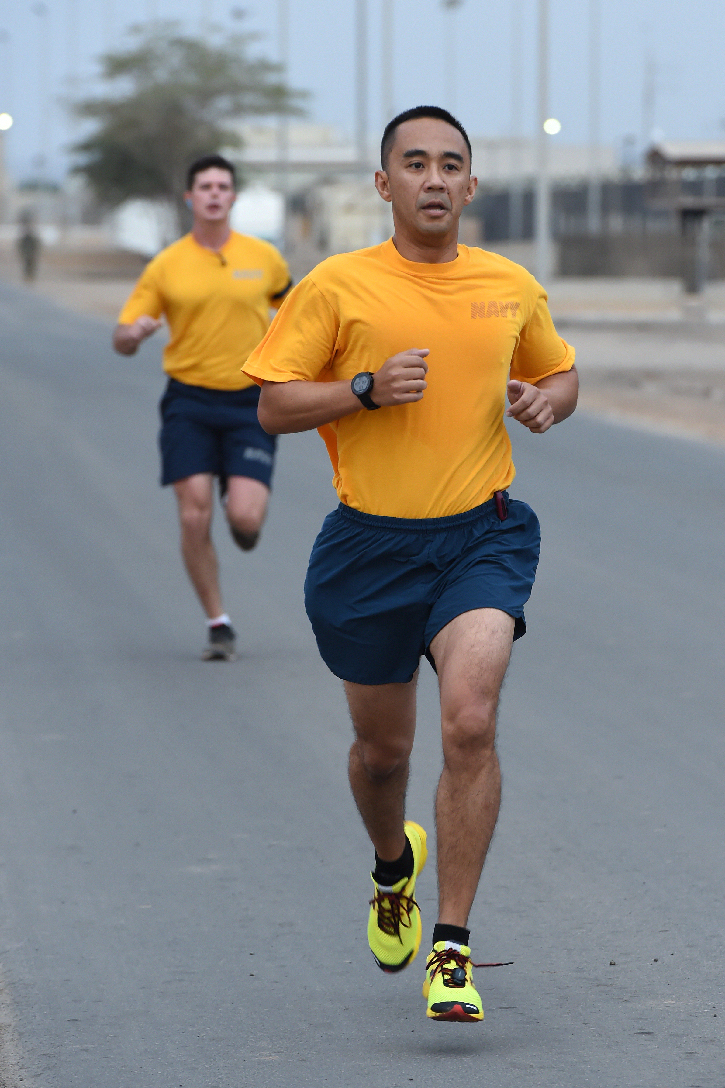 U.S. Navy Lt. Cmdr. Michael Cagulada, military planner for Combined Joint Task Force-Horn of Africa (CJTF-HOA) leads his fellow Sailors to the halfway point of the 1.5 mile run during a practice physical readiness test (PRT) at Camp Lemonnier, Djibouti, Feb. 24, 2017. The test was intended to prepare Sailors assigned to CJTF-HOA for the implementation of the Navy Physical Fitness Assessment program which consists of a standard medical screening, body composition assessment and a PRT to evaluate strength, endurance and cardiovascular fitness. (U.S. Air National Guard photo by Master Sgt. Paul Gorman)